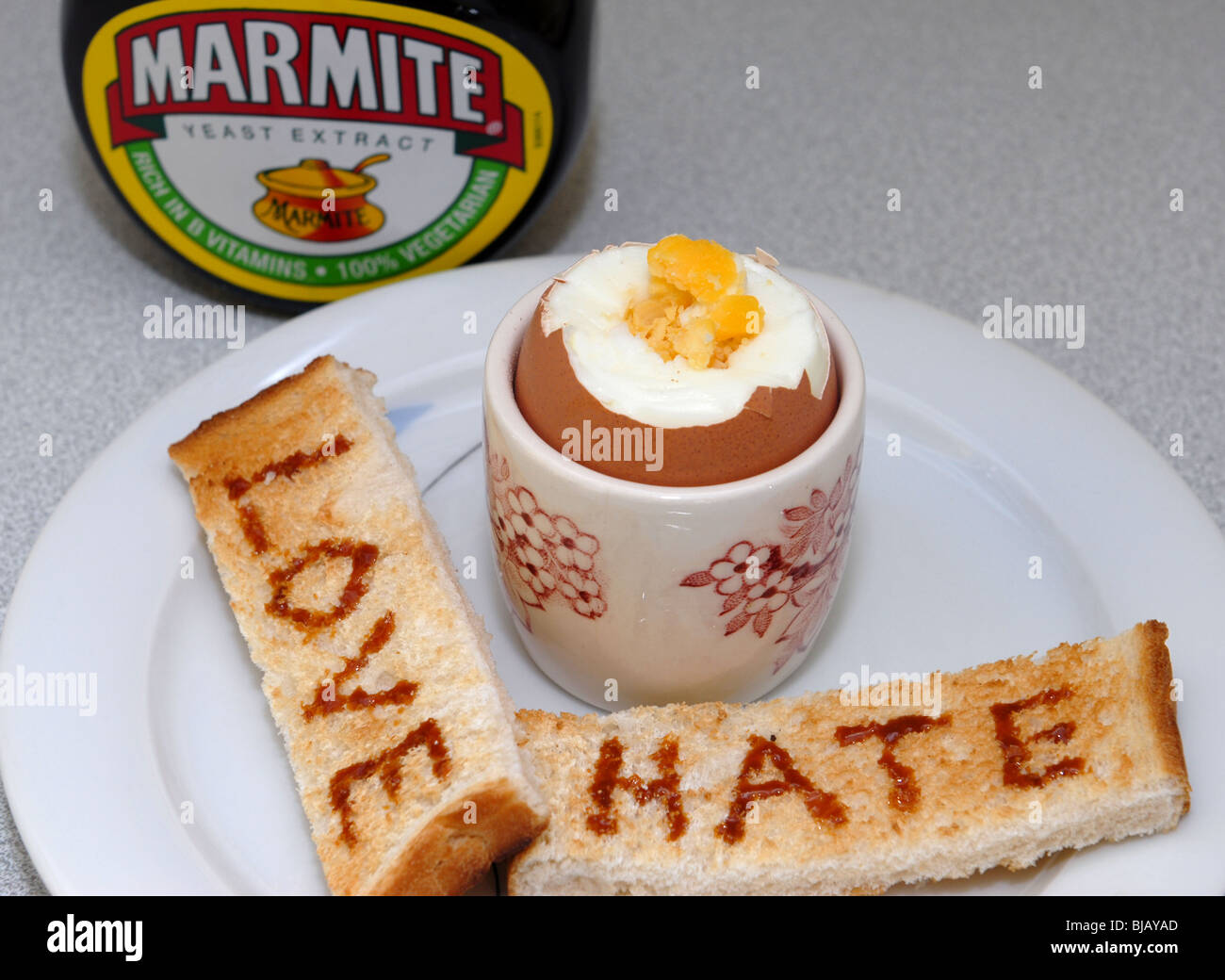 Generic image of Marmite with Love and Hate written on toast.  A Unilever Brand guaranteed to cause arguments. Stock Photo