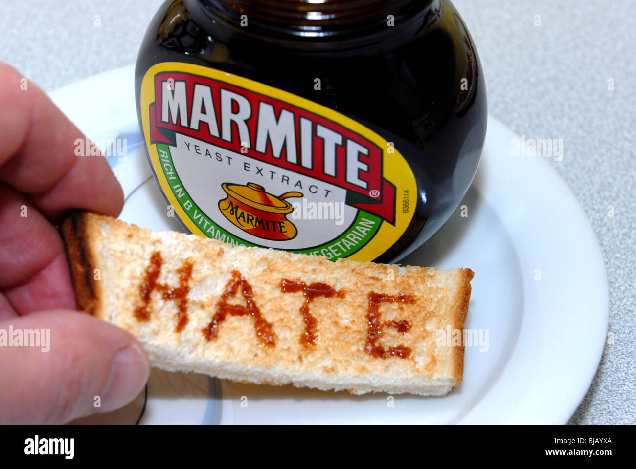 Generic image of Marmite with Love and Hate written on toast.  A Unilever Brand guaranteed to cause arguments - Stock Image
