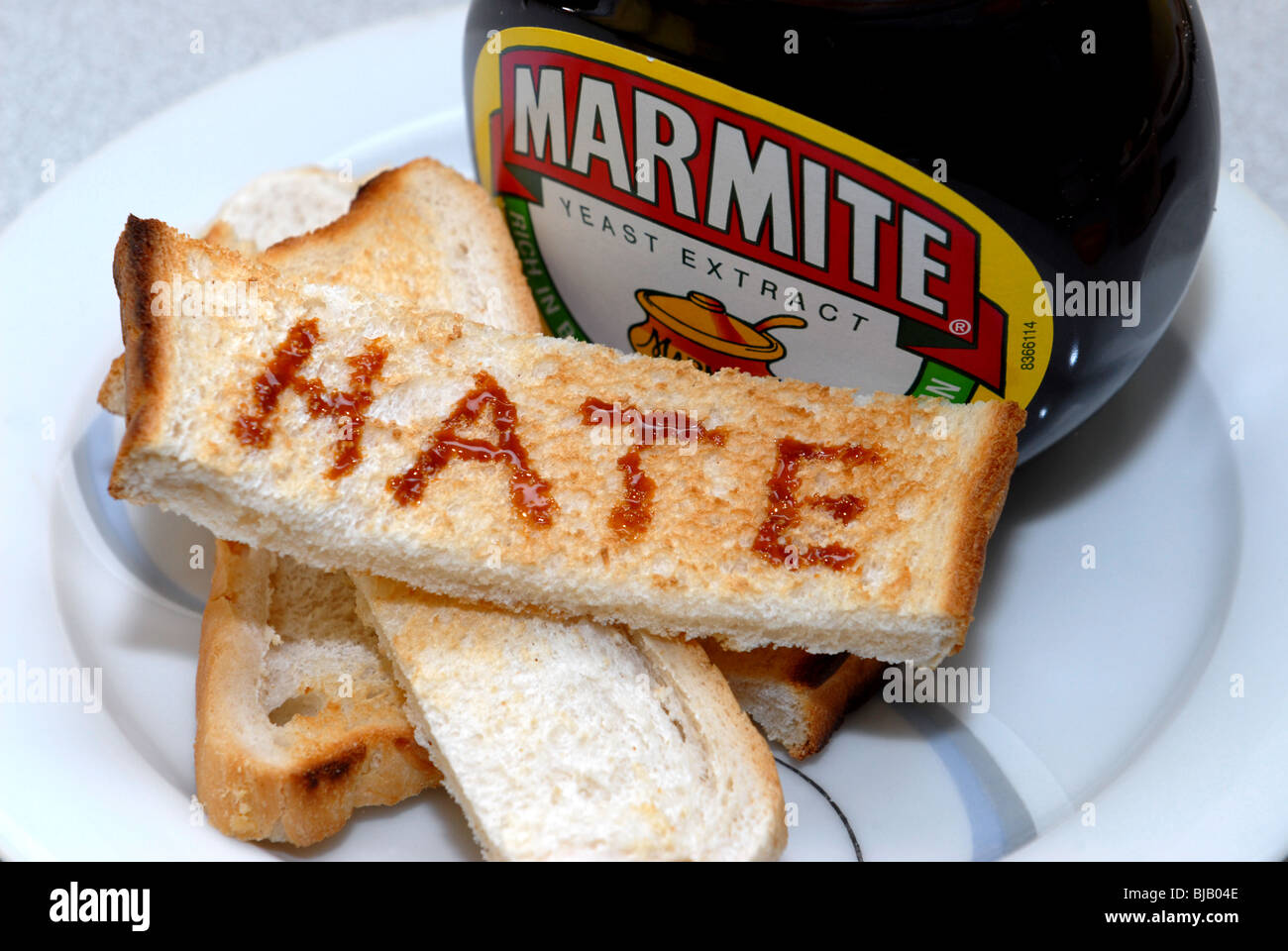 Generic image of Marmite with Love and Hate written on toast.  A Unilever Brand guaranteed to cause arguments Stock Photo