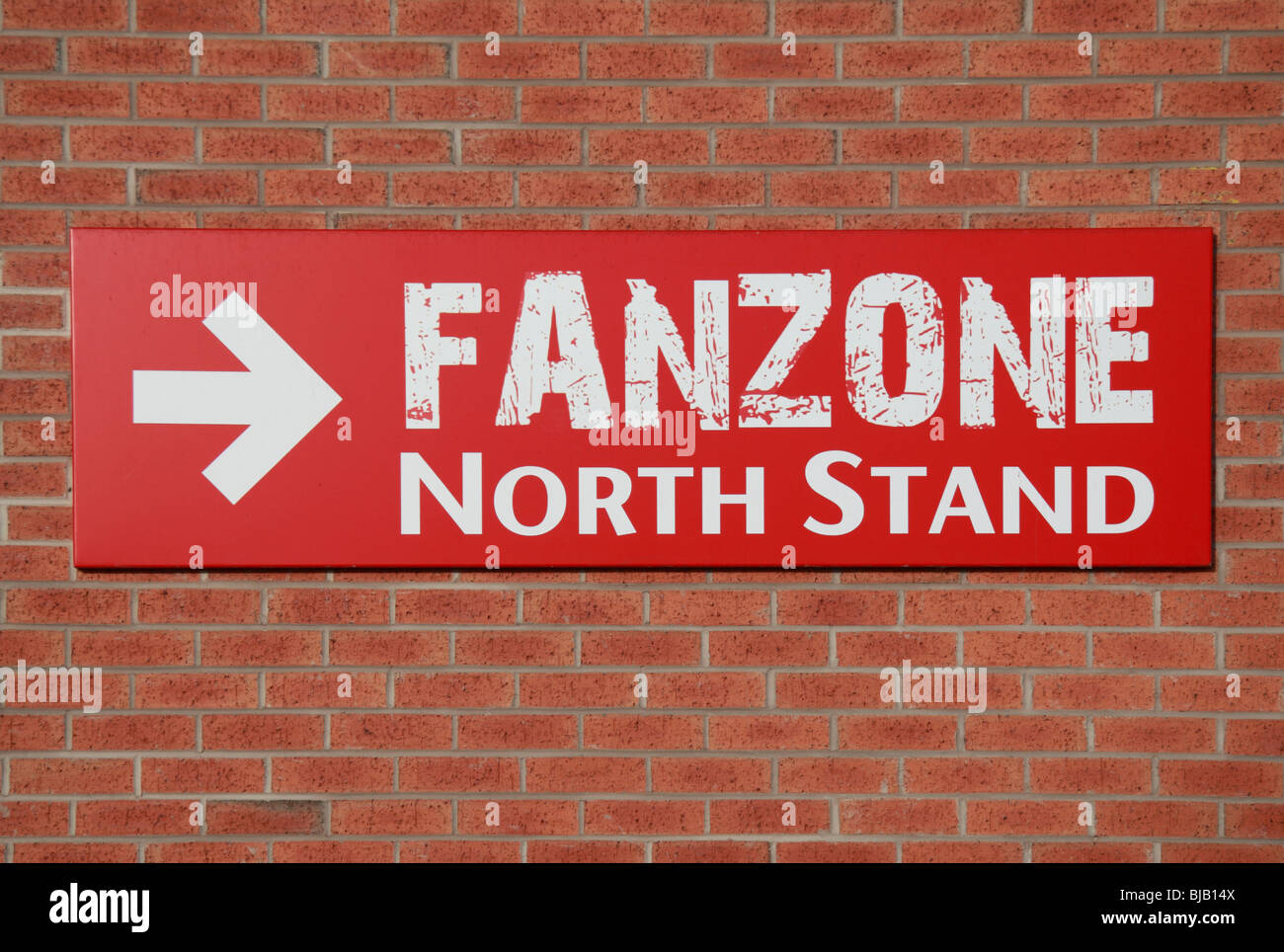 FanZone sign on the side of a Old Trafford football stadium, home ground of Manchester United. - Stock Image
