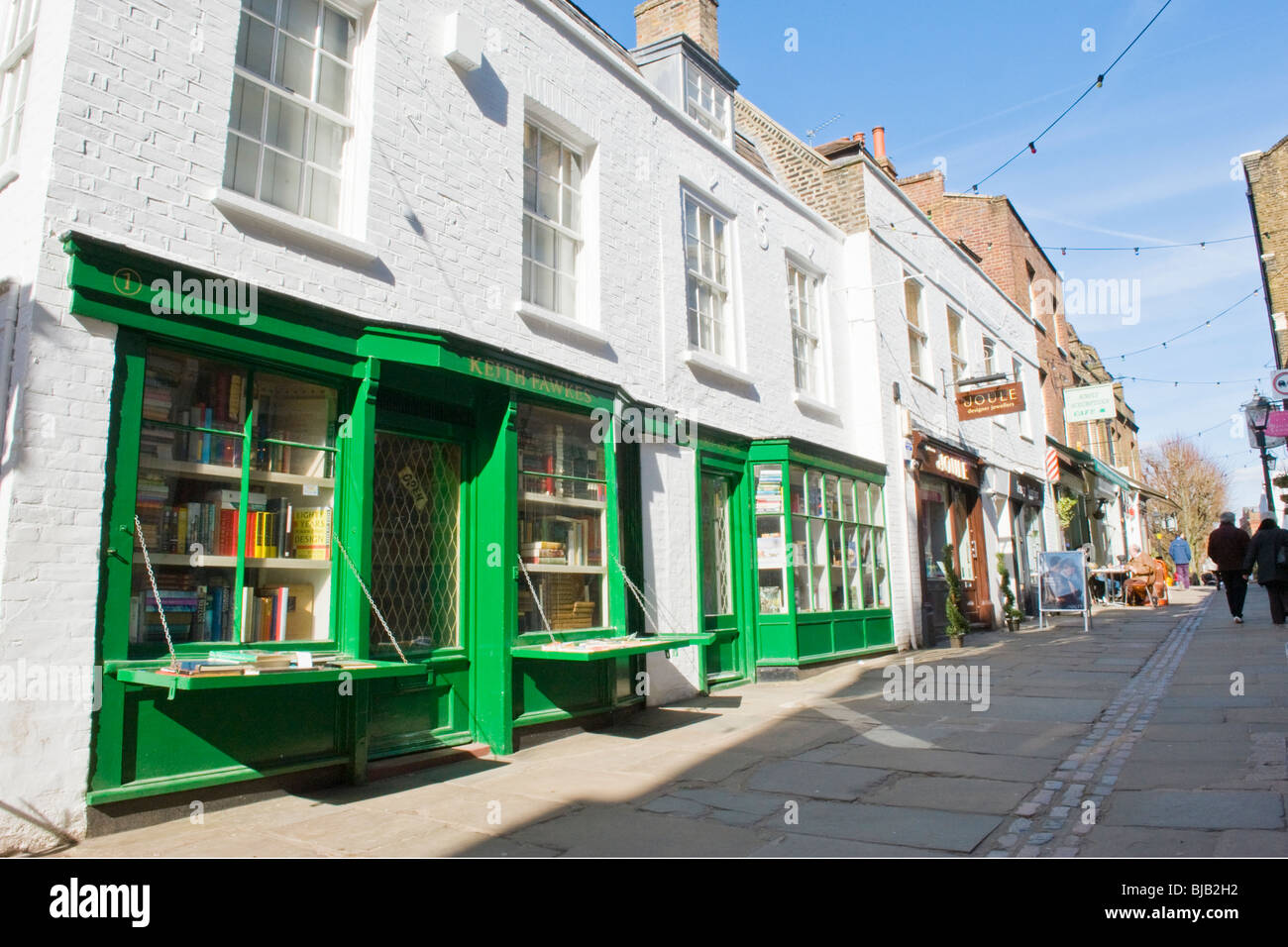 Hampstead , London , Flask Walk , pedestrian mews with Keith Fawkes collectible old & antique book shop in foreground - Stock Image