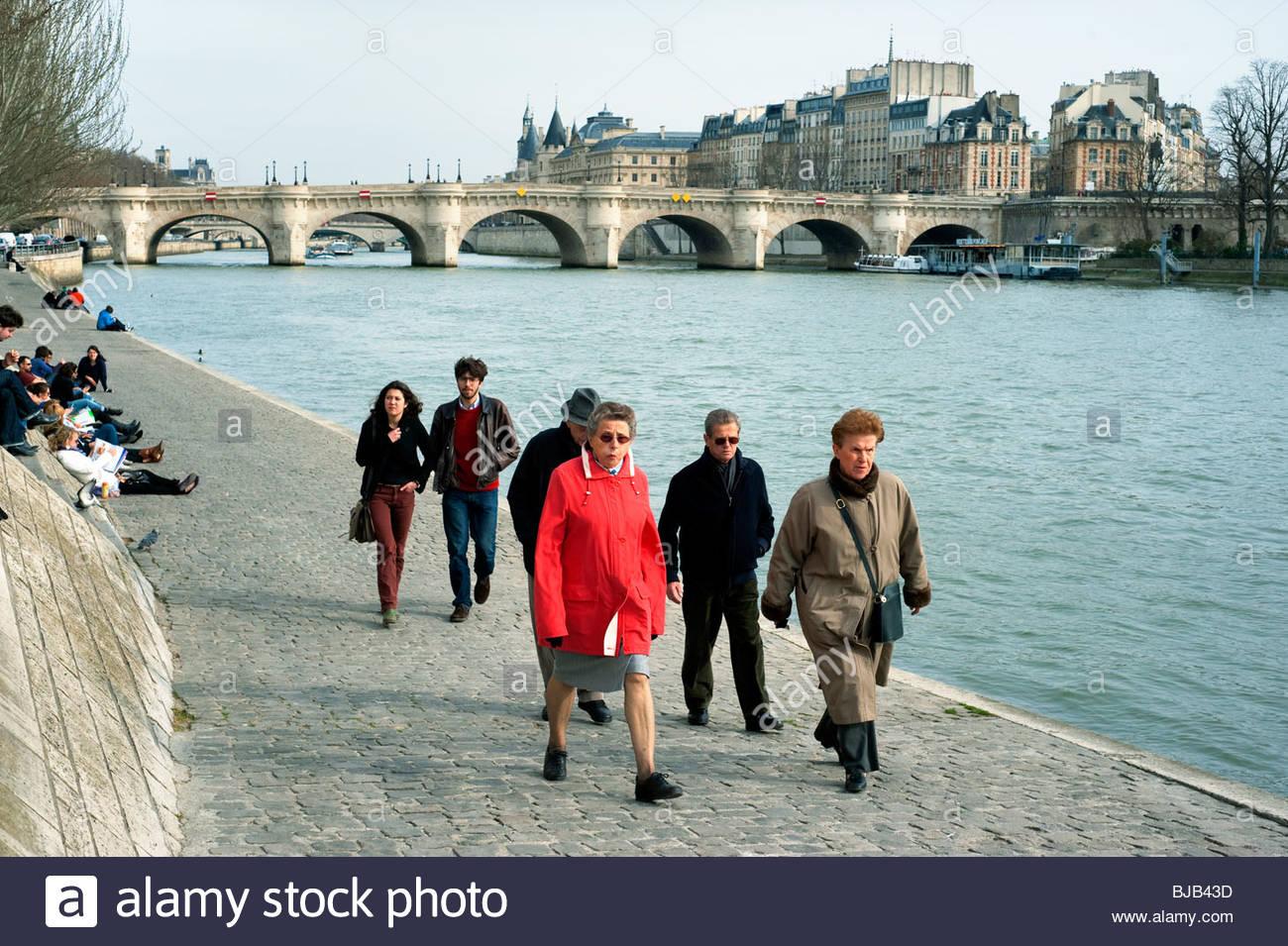 Senior people walking along Seine river, Paris, France, Stock Photo