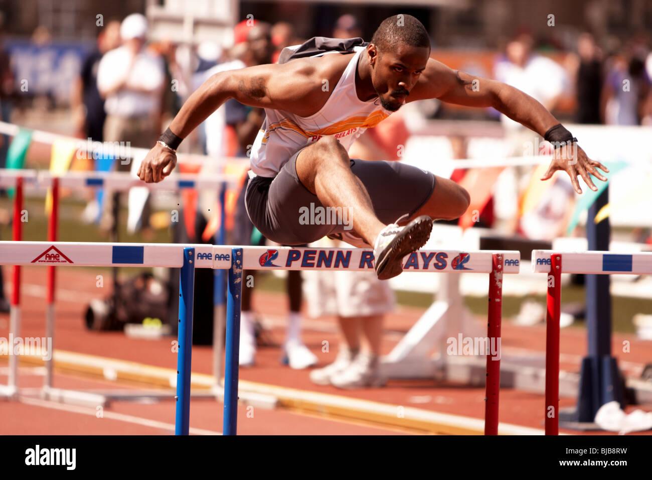 April 25, 2008. University of Pennsylvania. Penn Relays 2008. Hurdler completes the hurdle. - Stock Image
