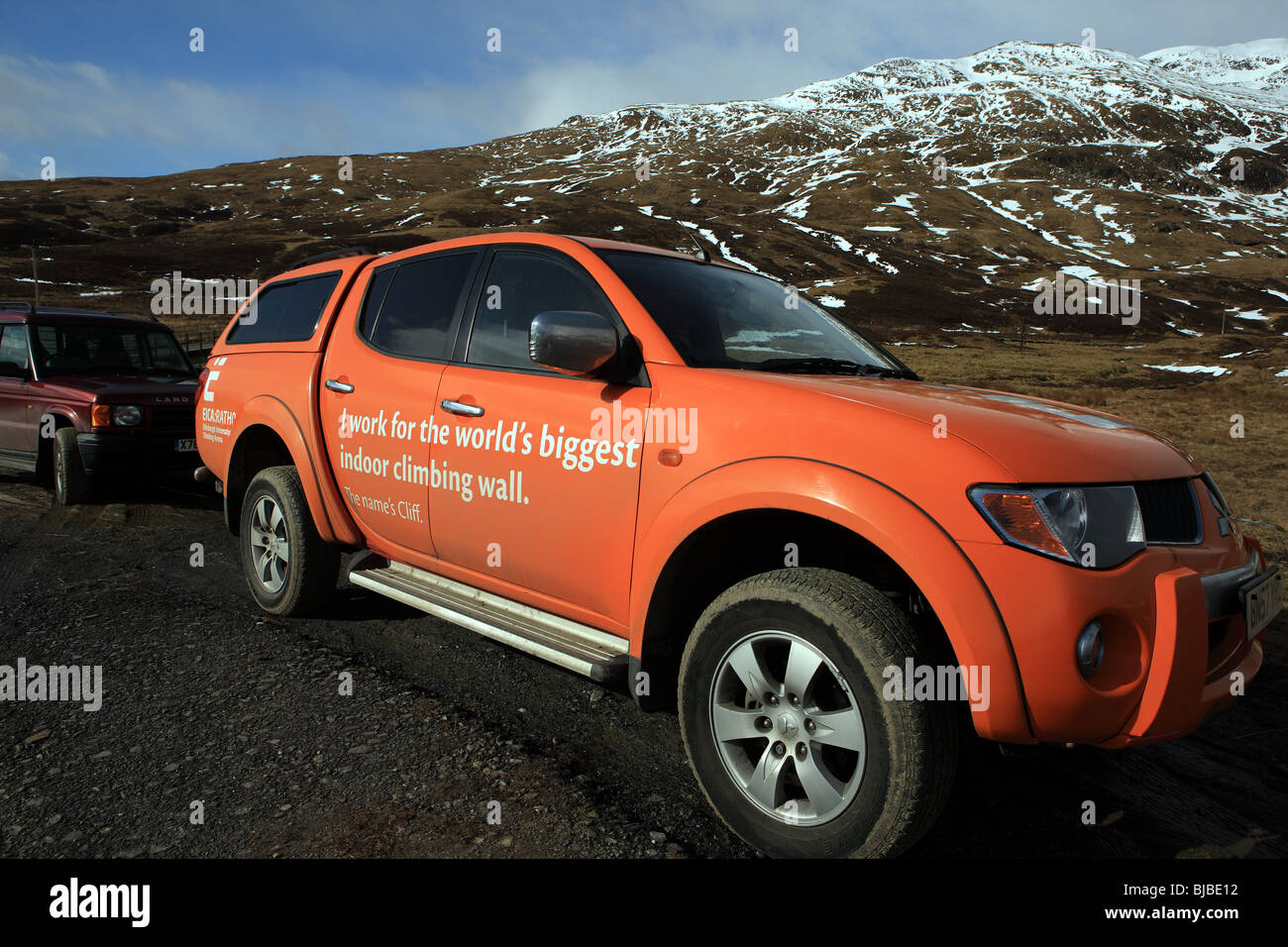 Car advertising Ratho in Edinburgh which is the world's biggest indoor climbing wall - Stock Image