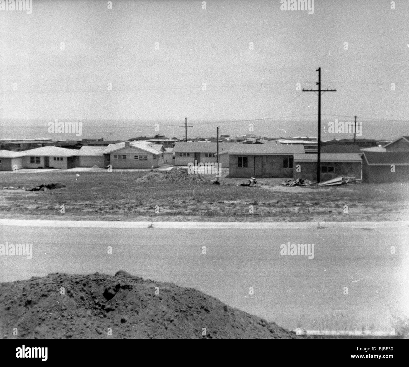 Tract homes under construction in the American southwest during the 1960s black and white horizontal - Stock Image