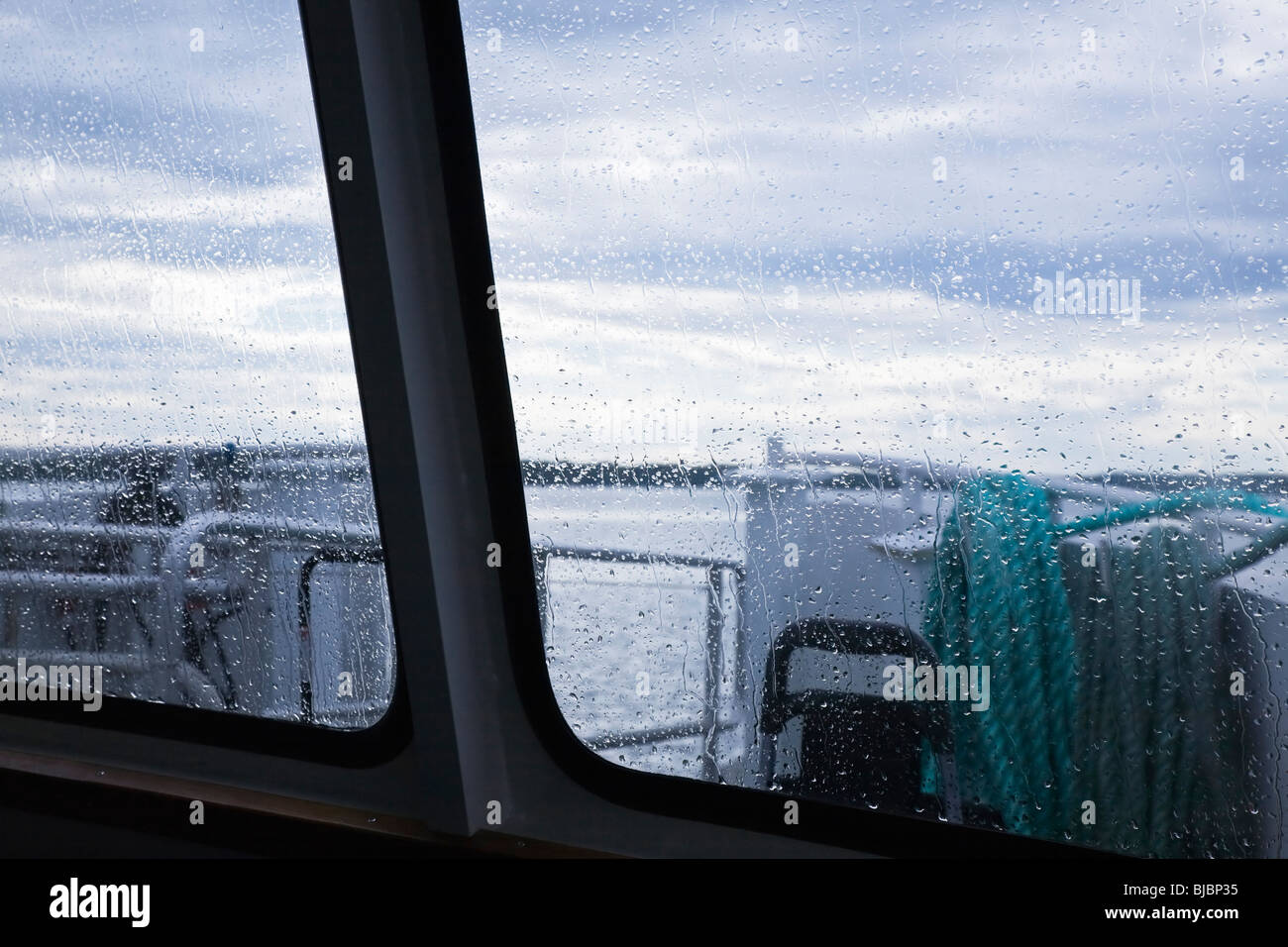Through the bow window of a passenger boat on a rainy day. - Stock Image