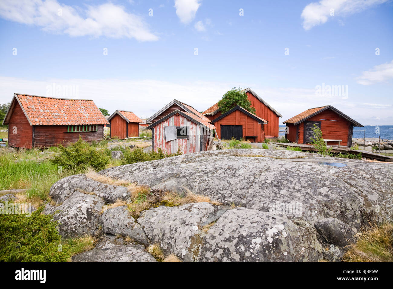 "Traditional red painted fisherman's huts on the island of Svartloga""in the ""Archipelago of Stockholm"" Sweden. Stock Photo"