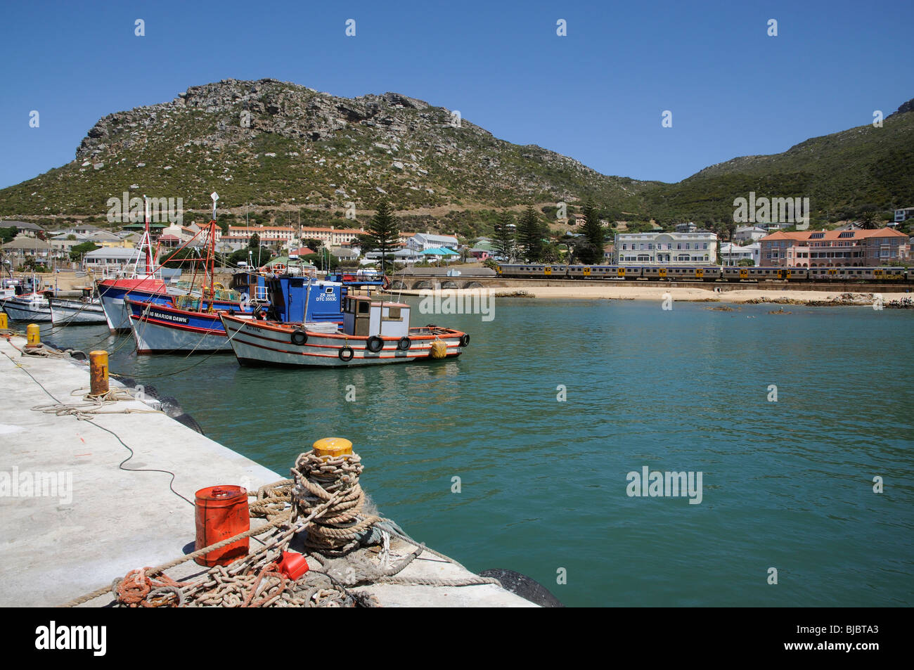 Fish Hoek harbour western cape South Africa close to Cape Town.Commuter train which takes the coastal route from - Stock Image