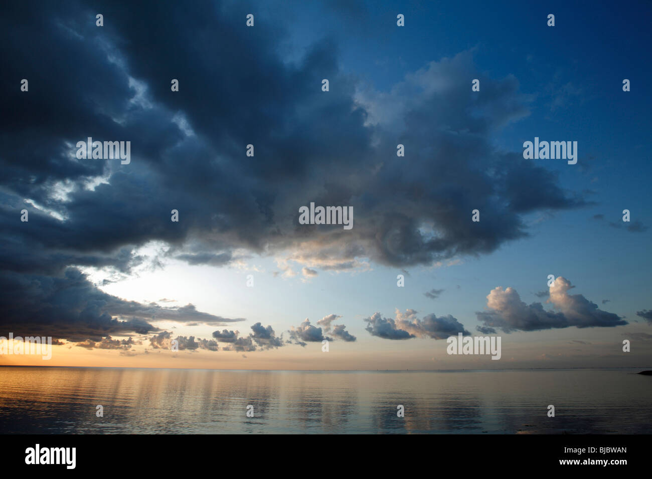 Thunder Clouds over Wadden Sea at Dawn, Texel Island, Holland - Stock Image