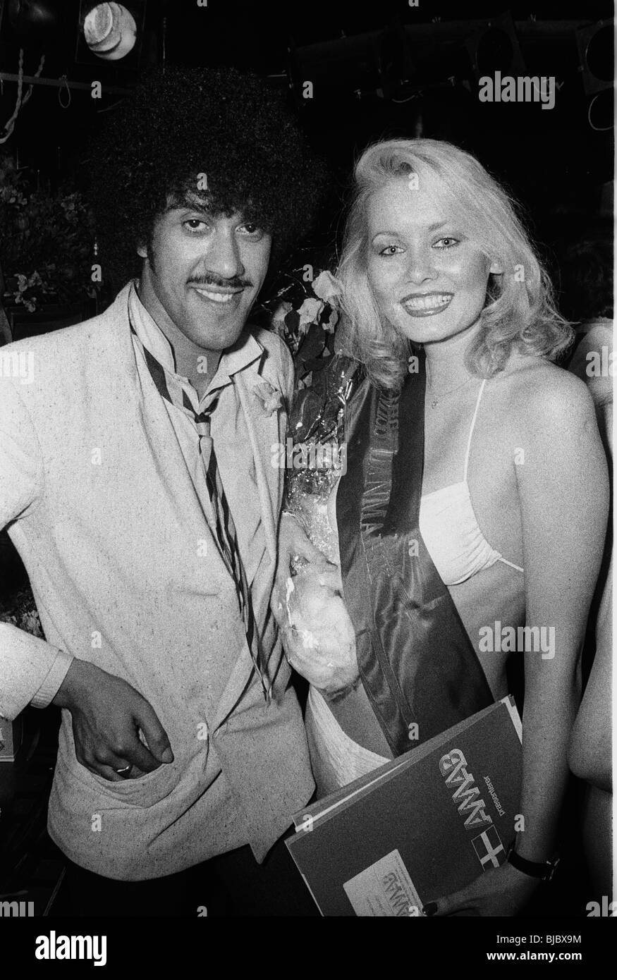 Phil Lynott as a jury member with the winner of a beauty-contest in a Copenhagen night club - Stock Image
