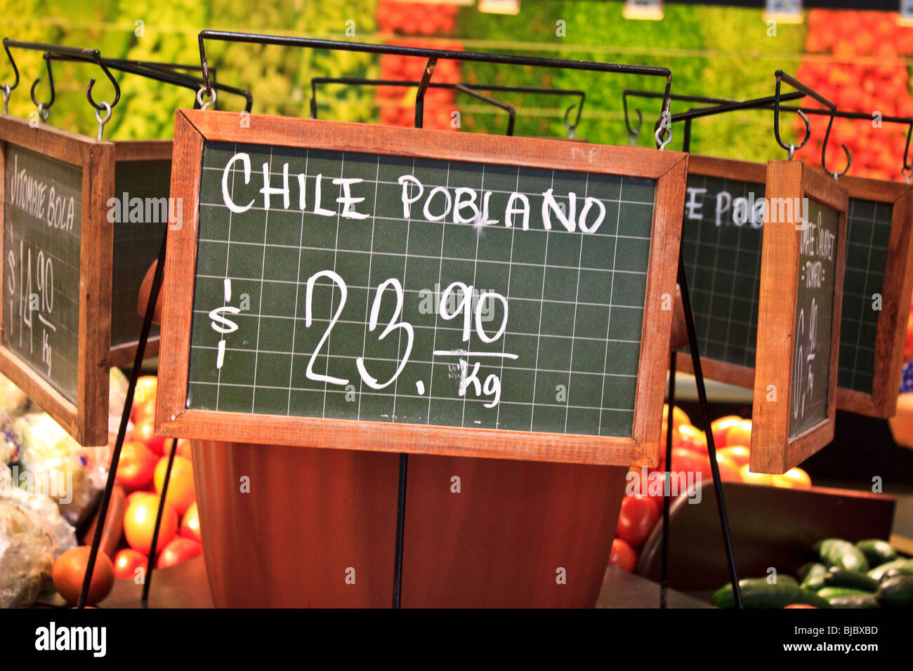 Sign showing the price in Mexican pesos for chile poblano Stock Photo