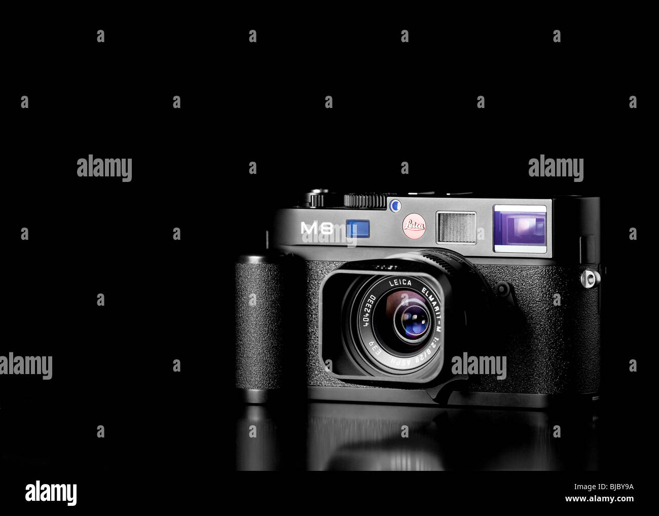 Black studio photograph of a Leica M8 digital rangefinder camera with hand grip and 28mm Elmarit lens - Stock Image