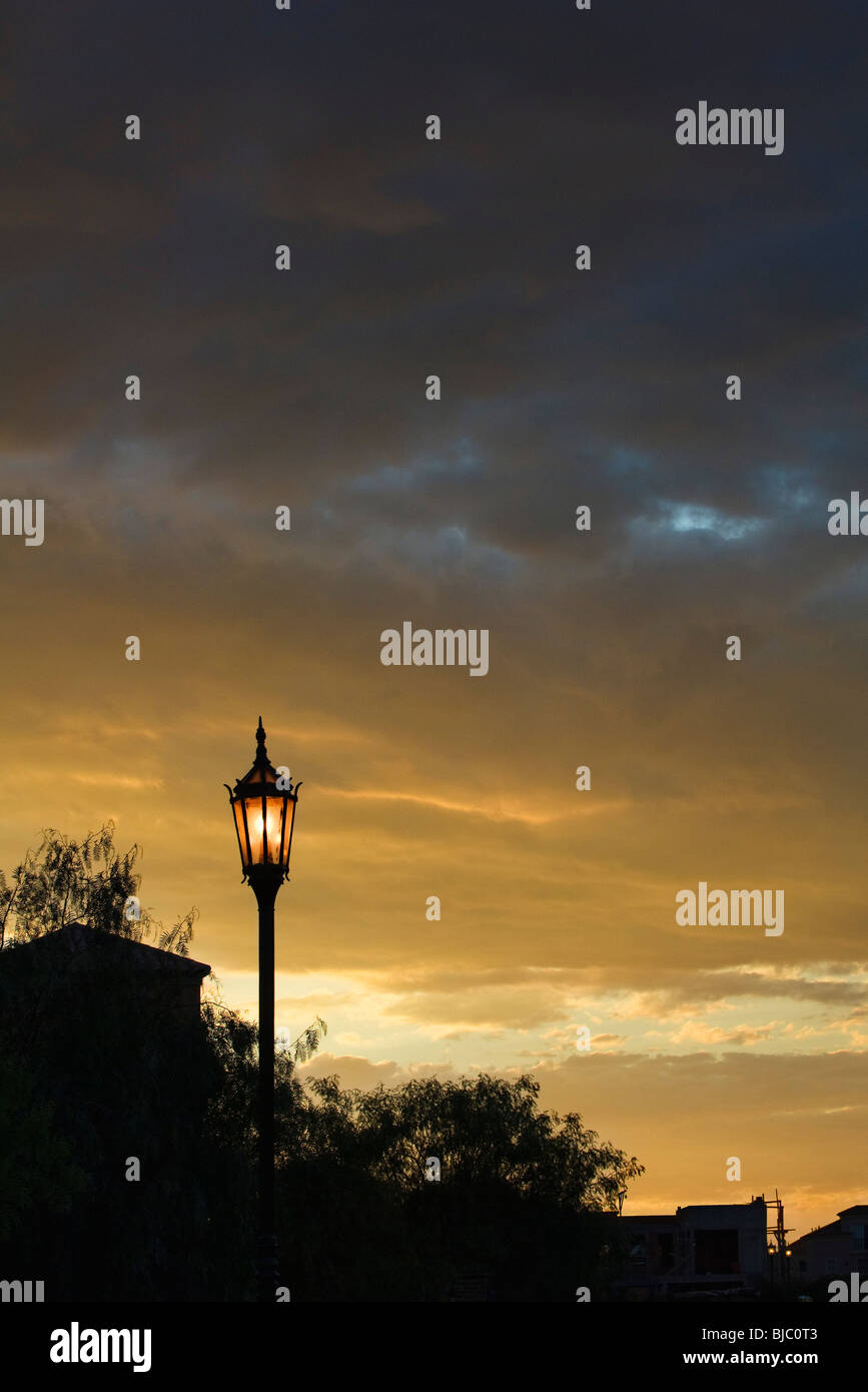 Street lamp illuminated at dusk - Stock Image