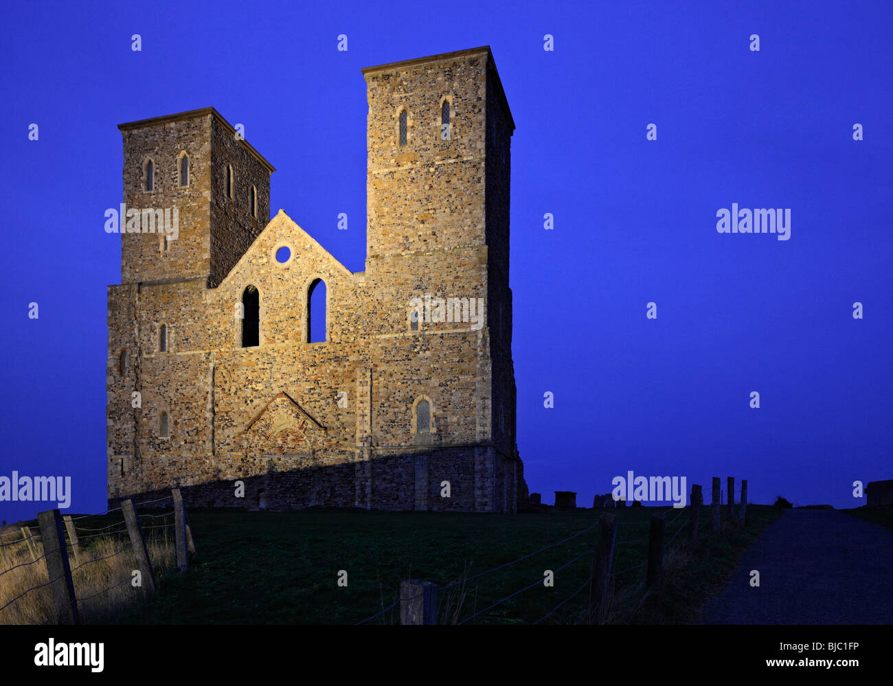 Reculver Towers floodlit at night. - Stock Image