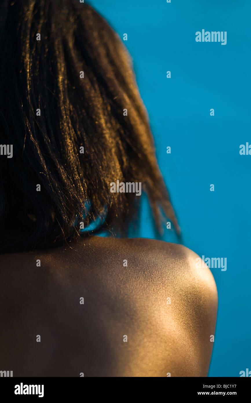 Woman's bare shoulder - Stock Image
