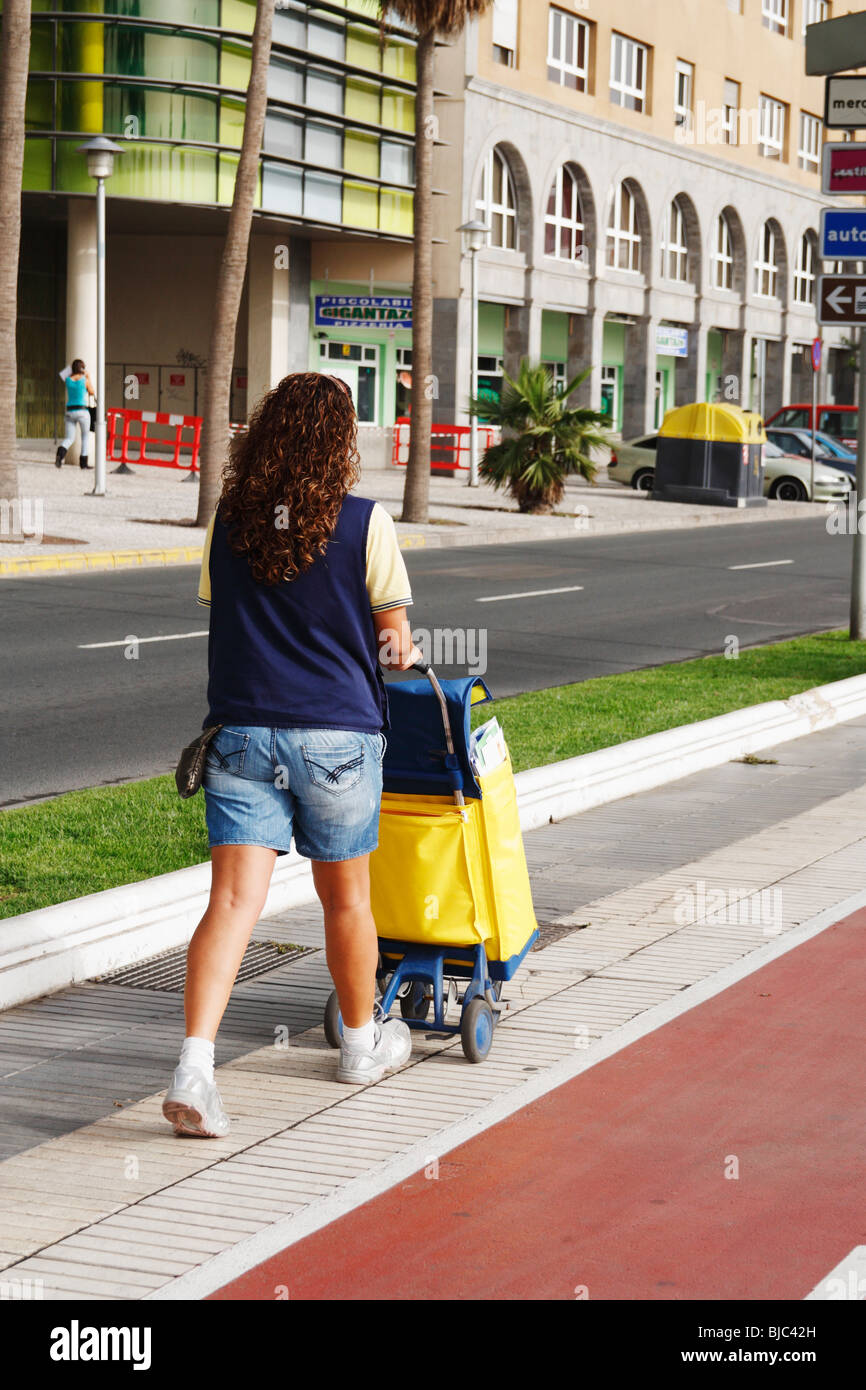 Spanish postal worker delivering mail on Gran Canaria in the Canary islands - Stock Image