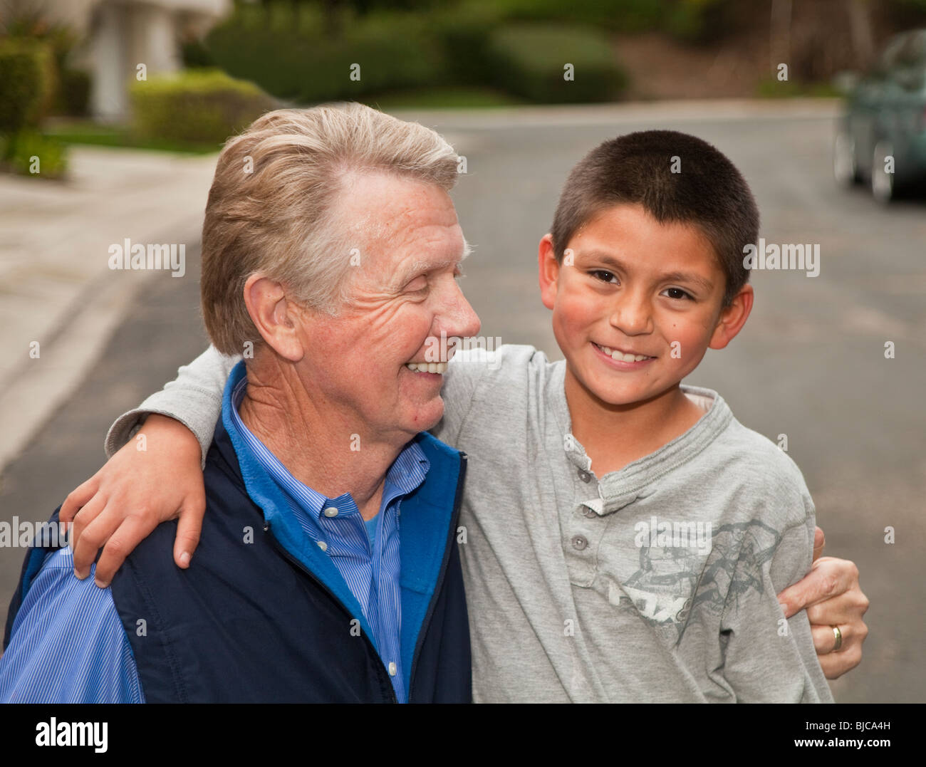 Grandfather and Hispanic adopted foster grandson 8-10 year old Family accepted accepting. California  MR  © - Stock Image