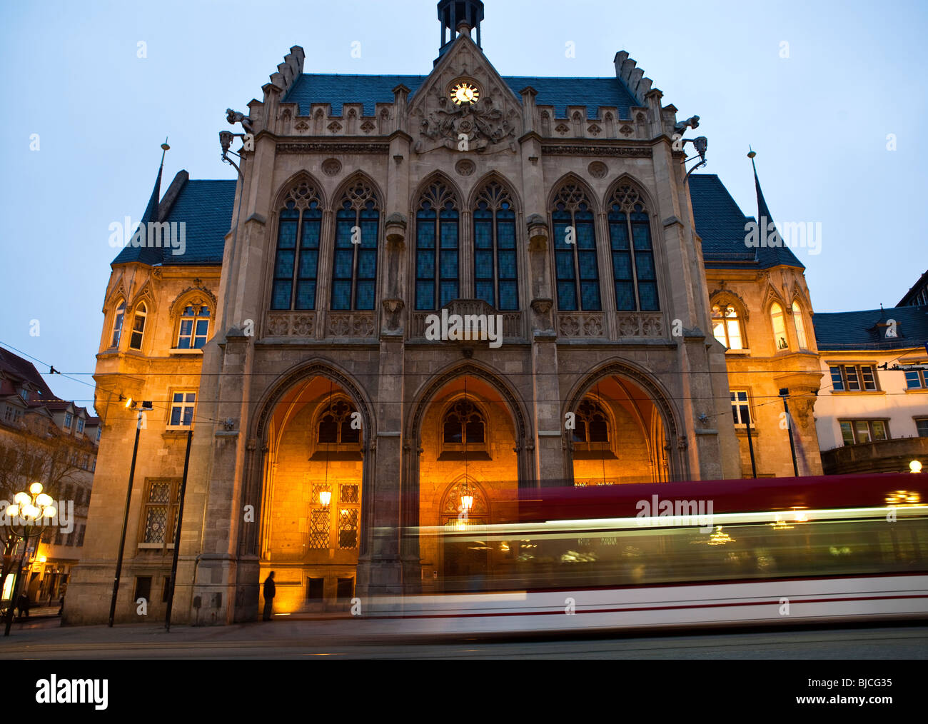 Erfurt Town hall in the evening with a tram passing by. (Long exposure) - Stock Image