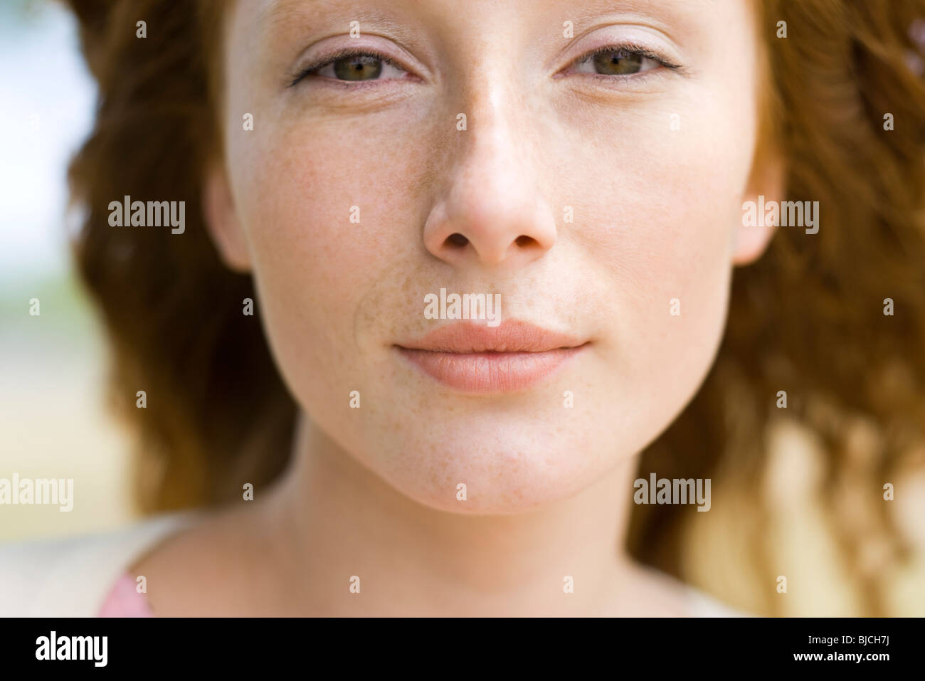 Young red-haired woman, portrait - Stock Image