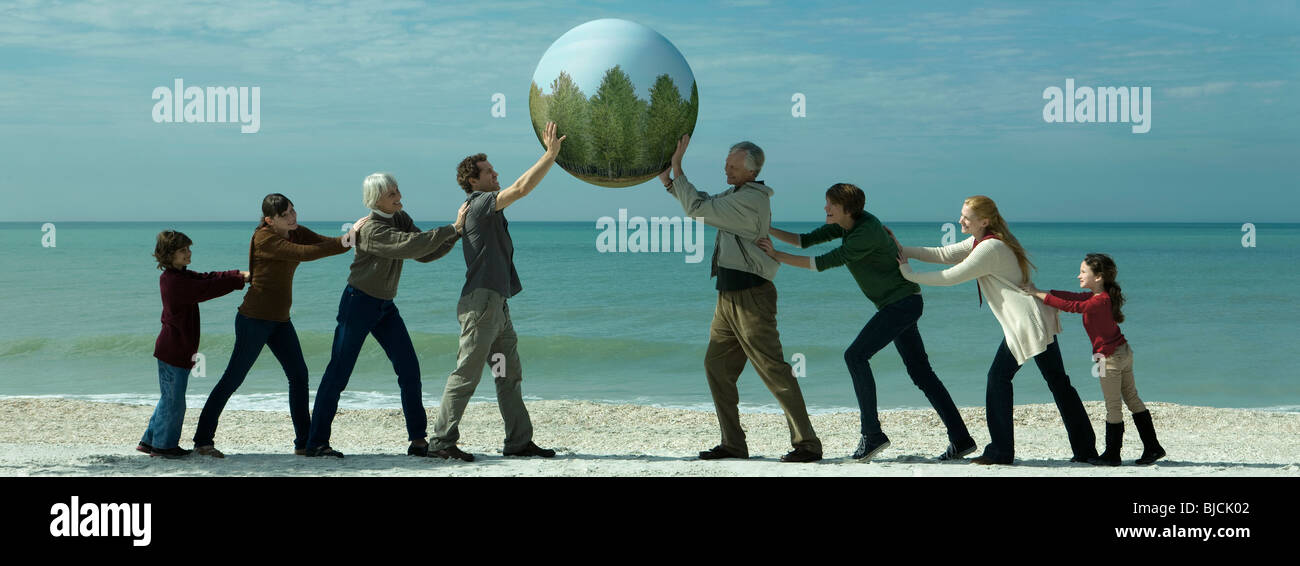 Ecology concept, group of people saving the earth together ...