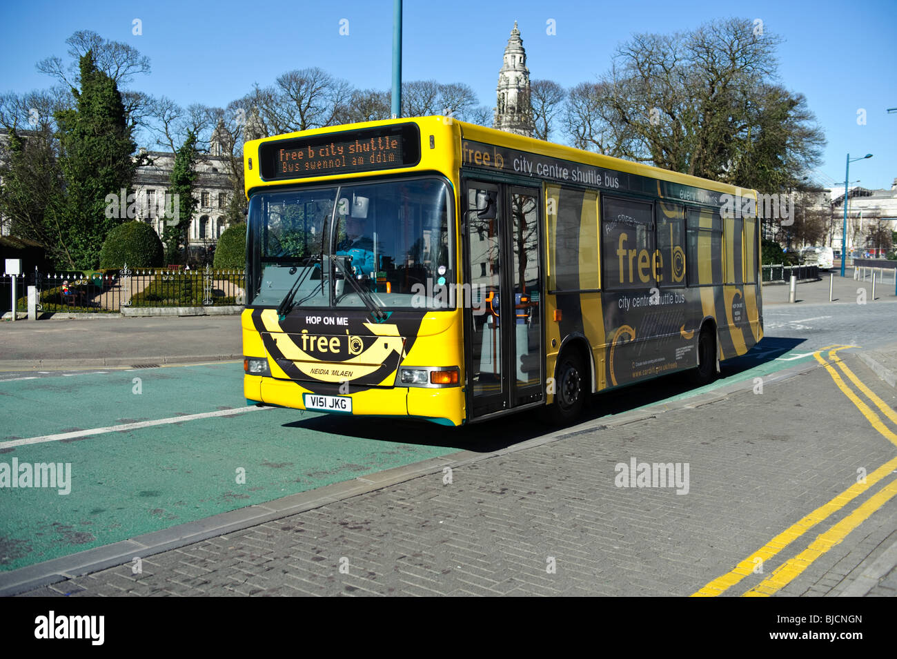 A yellow Free shuttle bus service for shoppers , Cardiff Wales UK - Stock Image