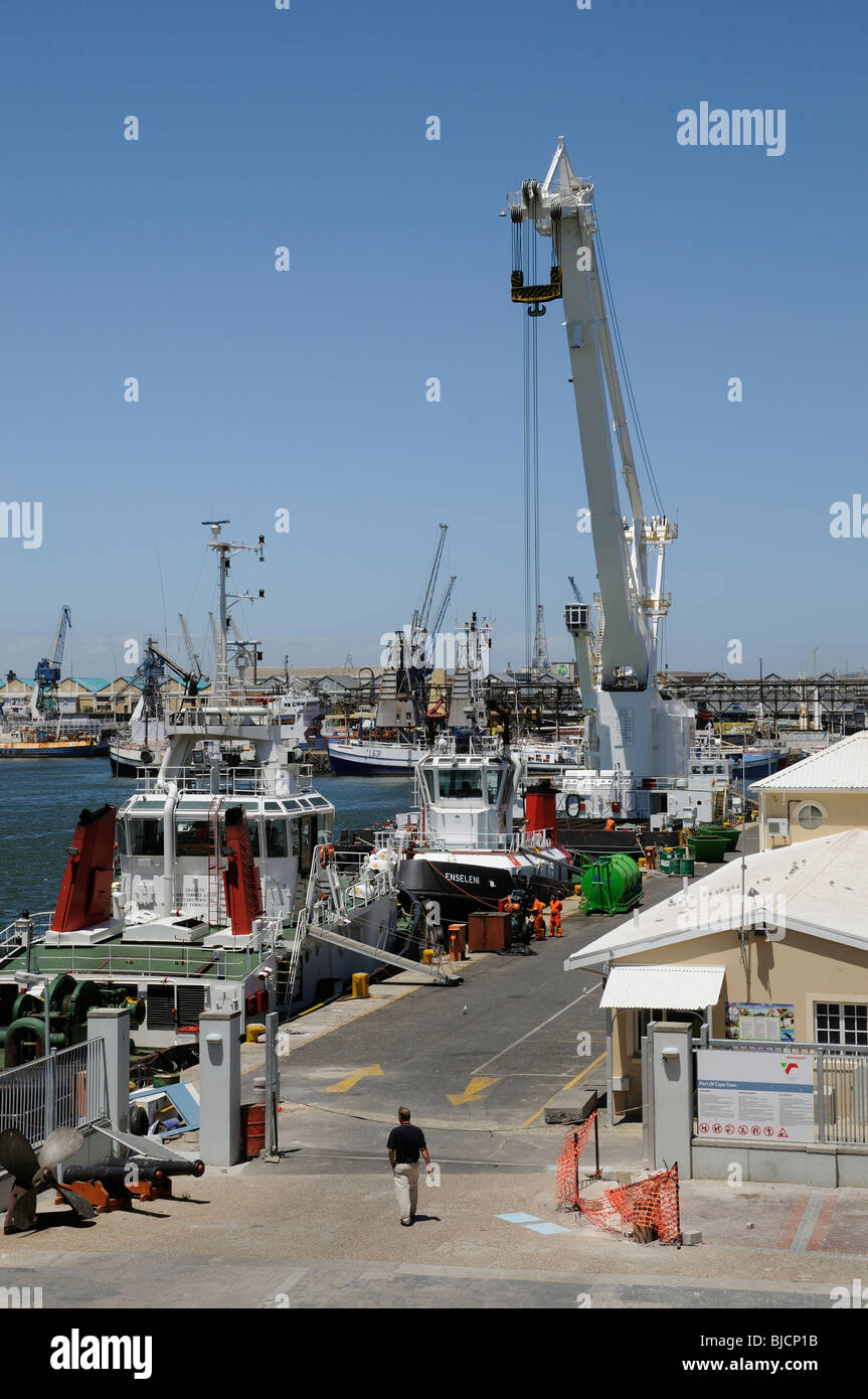 Port of Cape Town South Africa ocean going tugs and a large floating crane hoist alongside - Stock Image