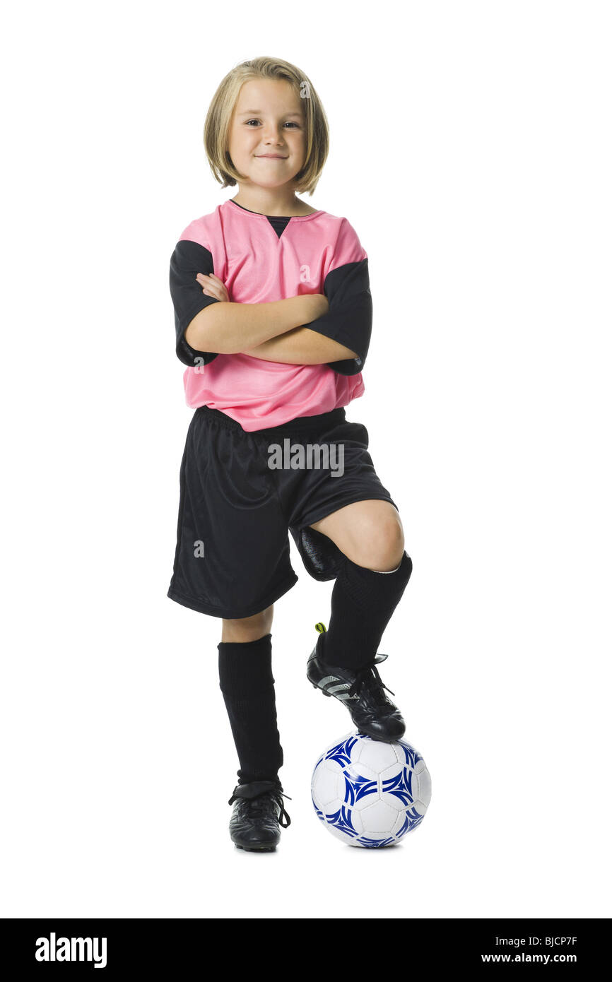 154a5f99b Young girl in a soccer uniform with ball Stock Photo  28555059 - Alamy