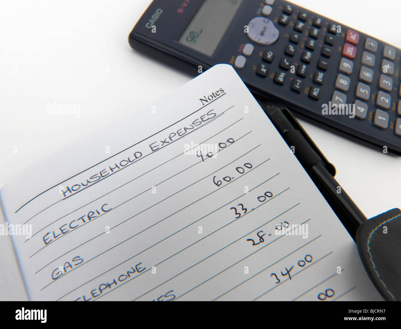 handwritten budget list calculator note book stock photo 28556227