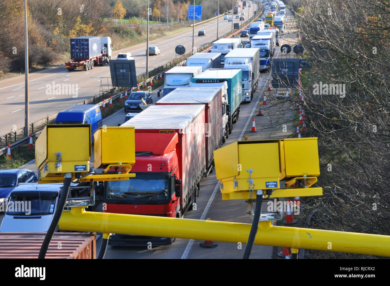 M25 Motorway average speed cameras and traffic jam Stock Photo