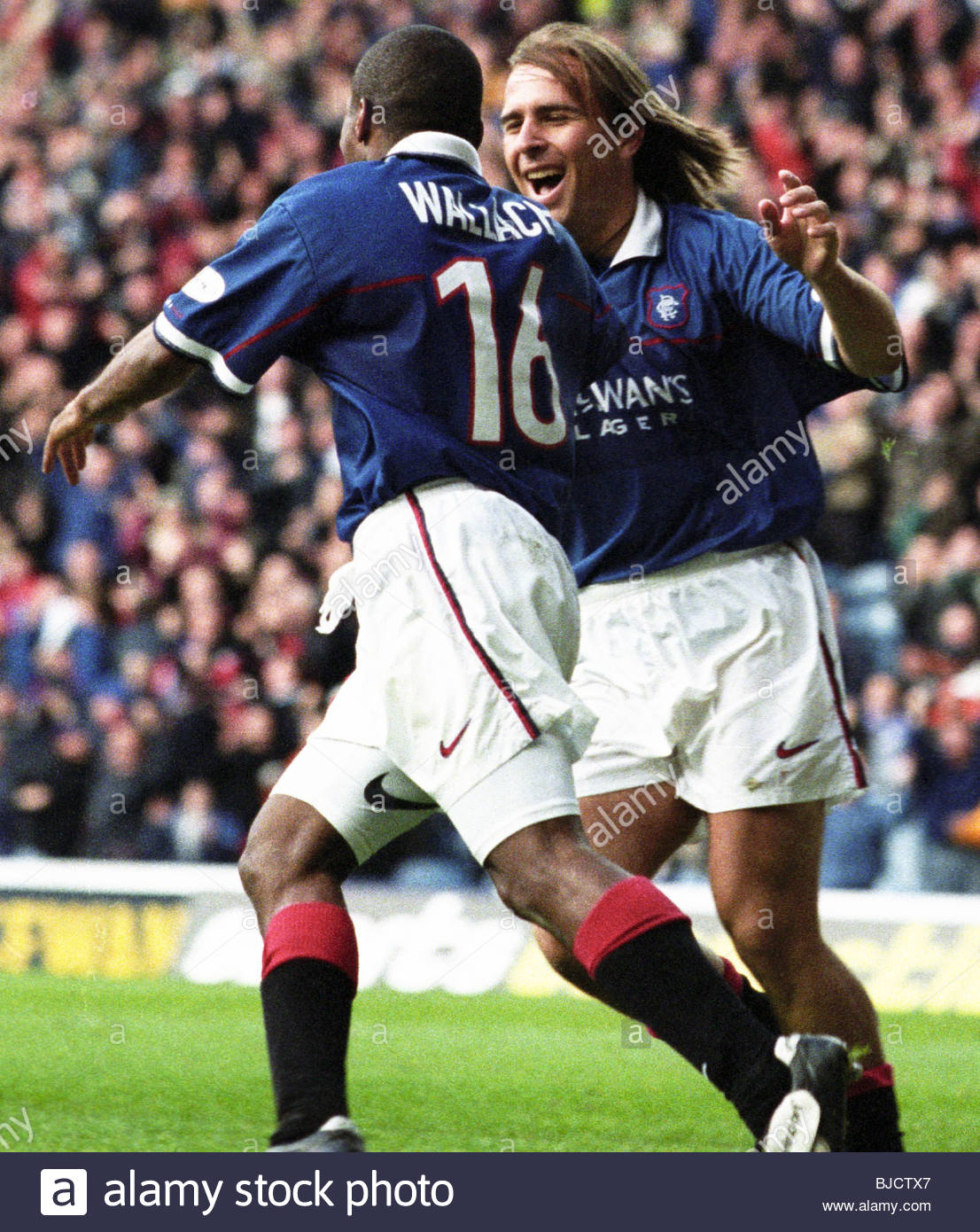 17/10/98 SPL RANGERS v HEARTS IBROX - GLASGOW Rangers' Rod Wallace celebrates his goal with team-mate Sebastian - Stock Image