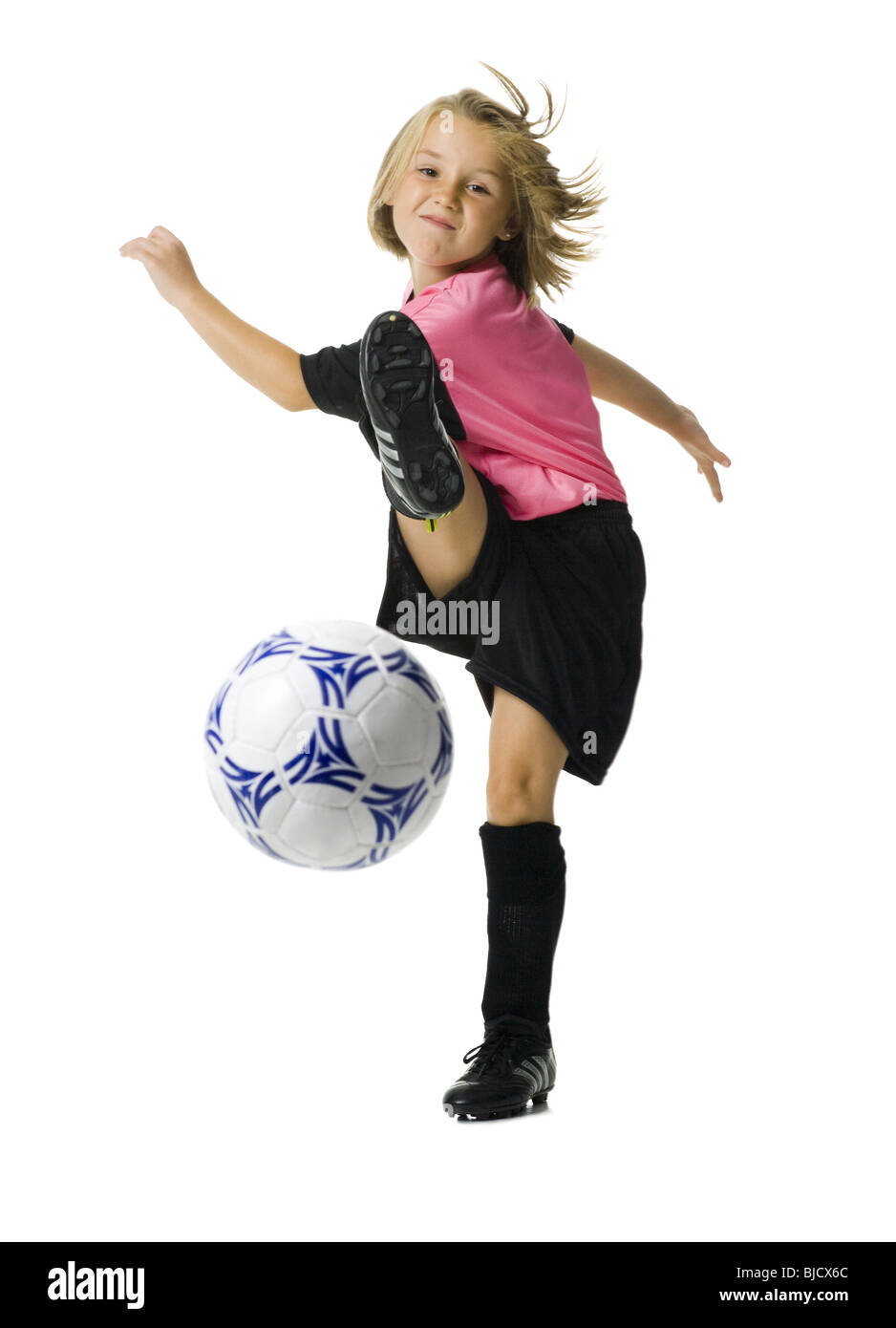 c456f2959 Young girl in a soccer uniform with ball Stock Photo  28558164 - Alamy
