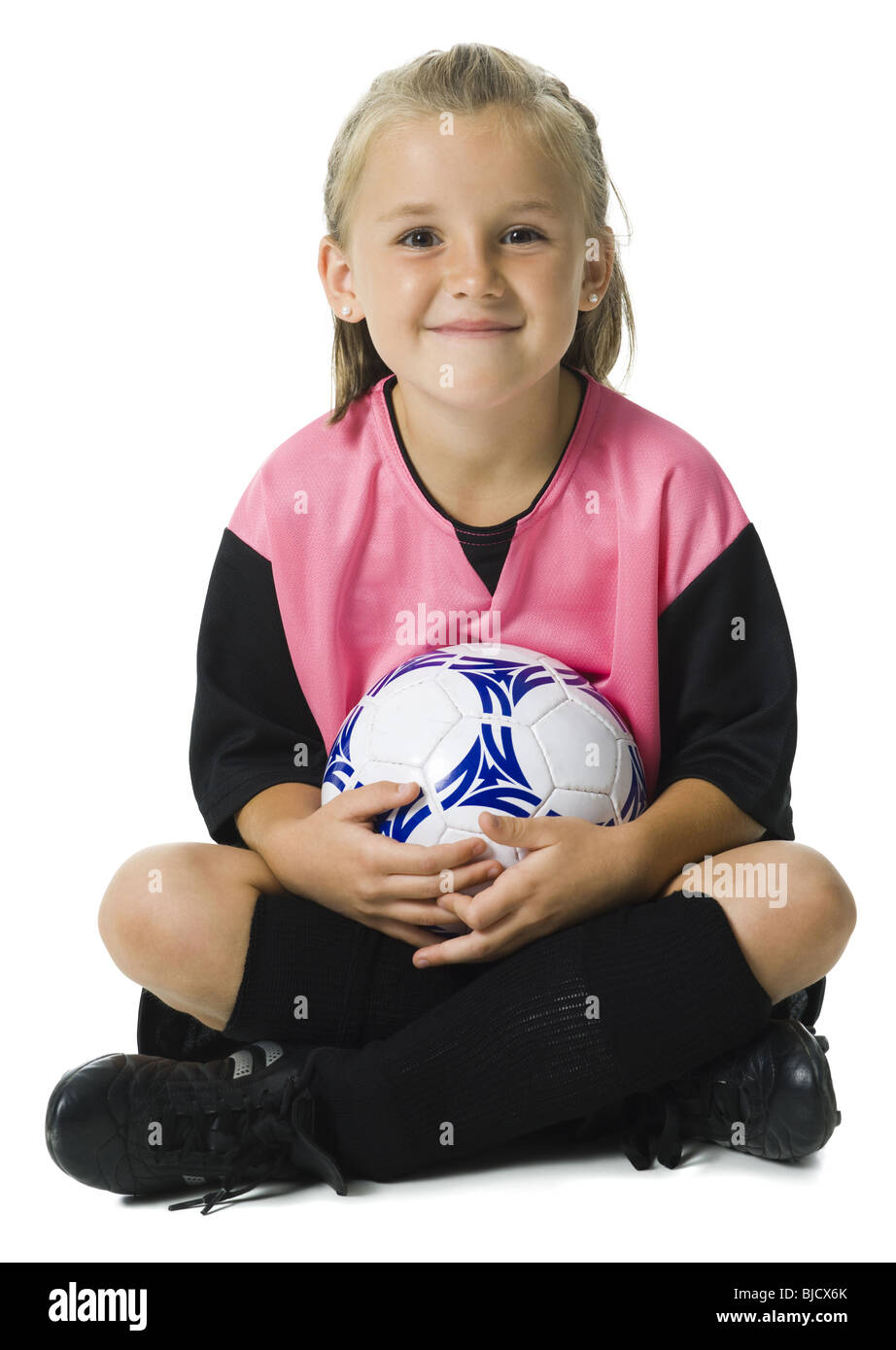 64756fa5a Young girl in a soccer uniform with ball Stock Photo  28558171 - Alamy