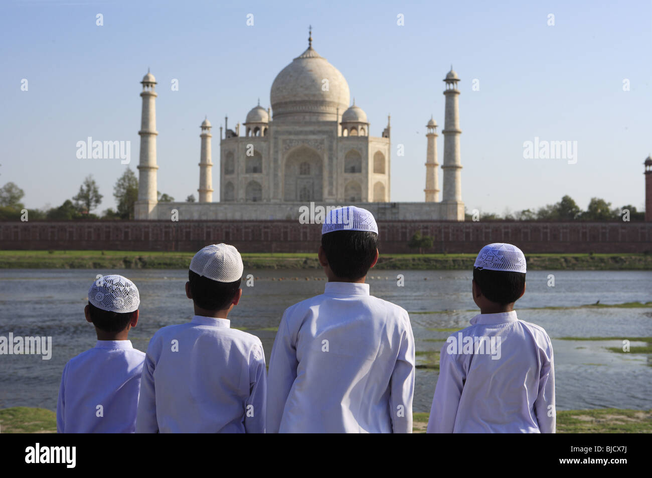 76b2f7de9ab9 Young muslim boys performing religious prayer Namaz in front of Taj Mahal  on bank of Yamuna river   Agra   Uttar Pradesh   India