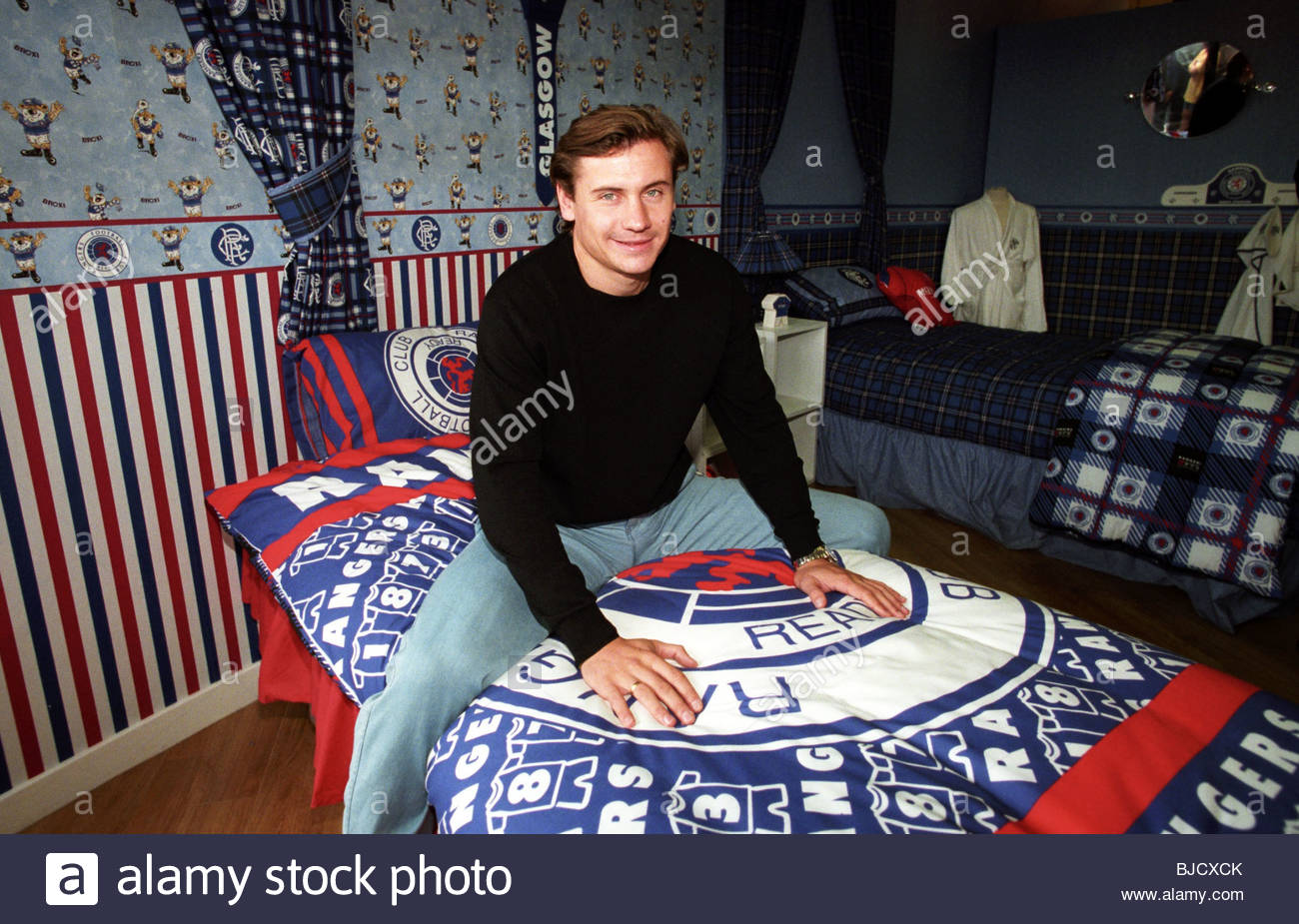 15/07/98 IBROX - GLASGOW New Rangers signing Andrei Kanchelskis in the club's Ibrox superstore. - Stock Image