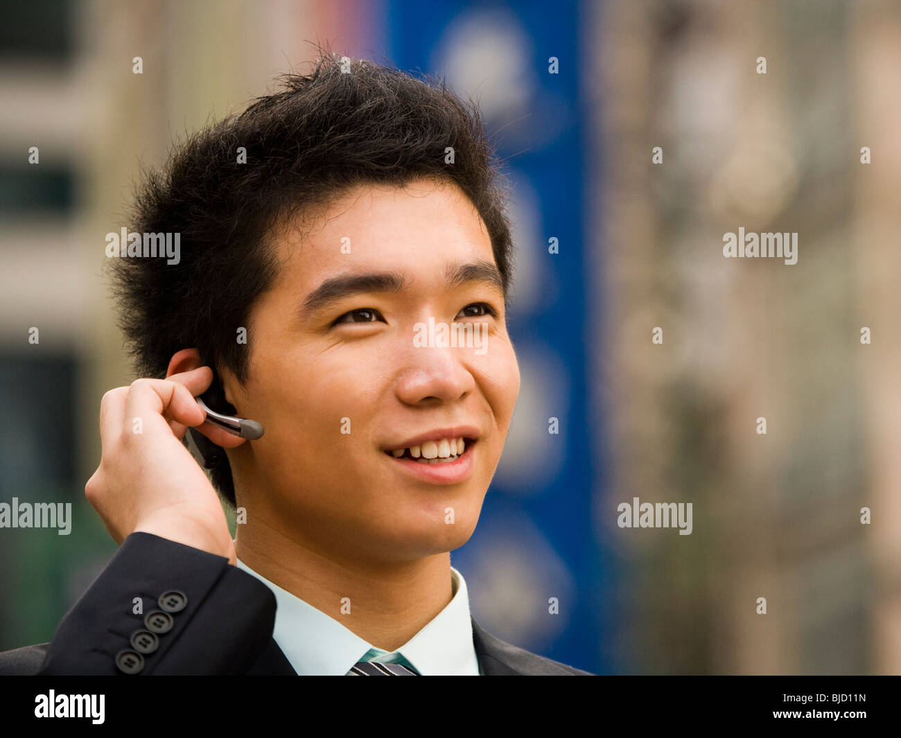 Man With A Cell Phone Earpiece Stock Photo Alamy
