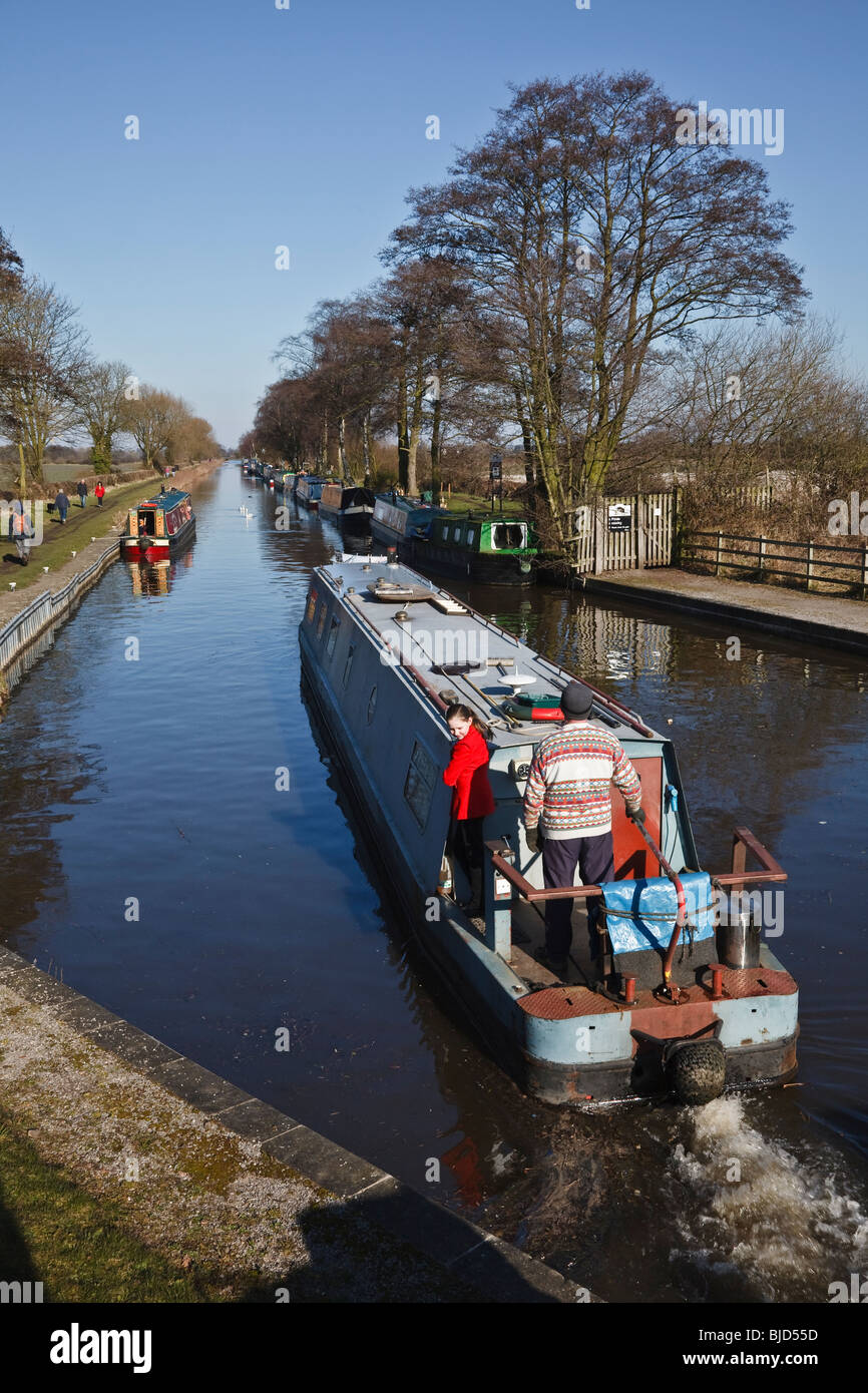 Narrowboat leaving a lock on the Trent and Mersey Canal at Fradley, Staffordshire - Stock Image