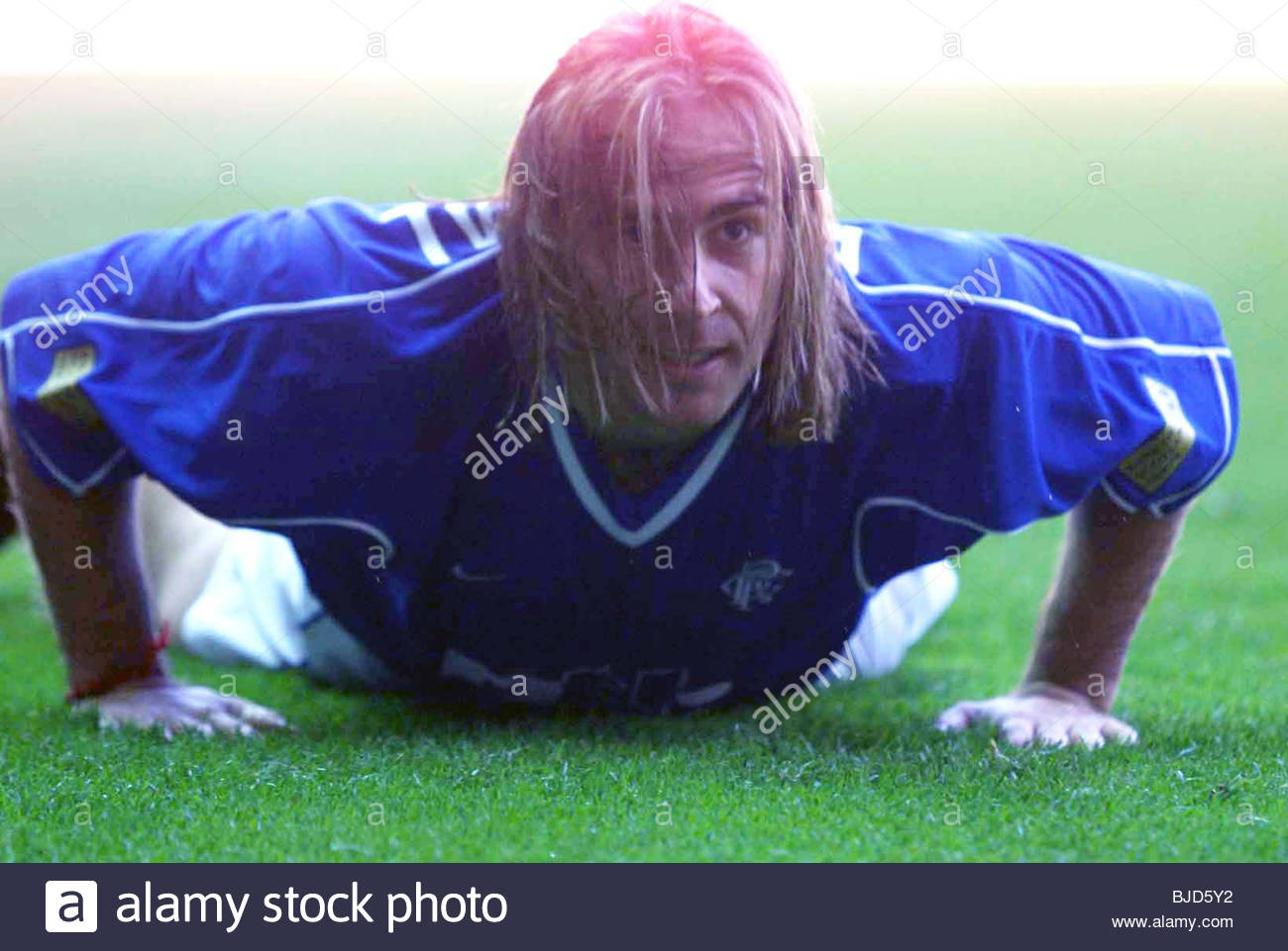 30/04/00 SPL RANGERS V DUNDEE (3-0) IBROX - GLASGOW Rangers' Sebastian Rozental picks himself up after missing - Stock Image