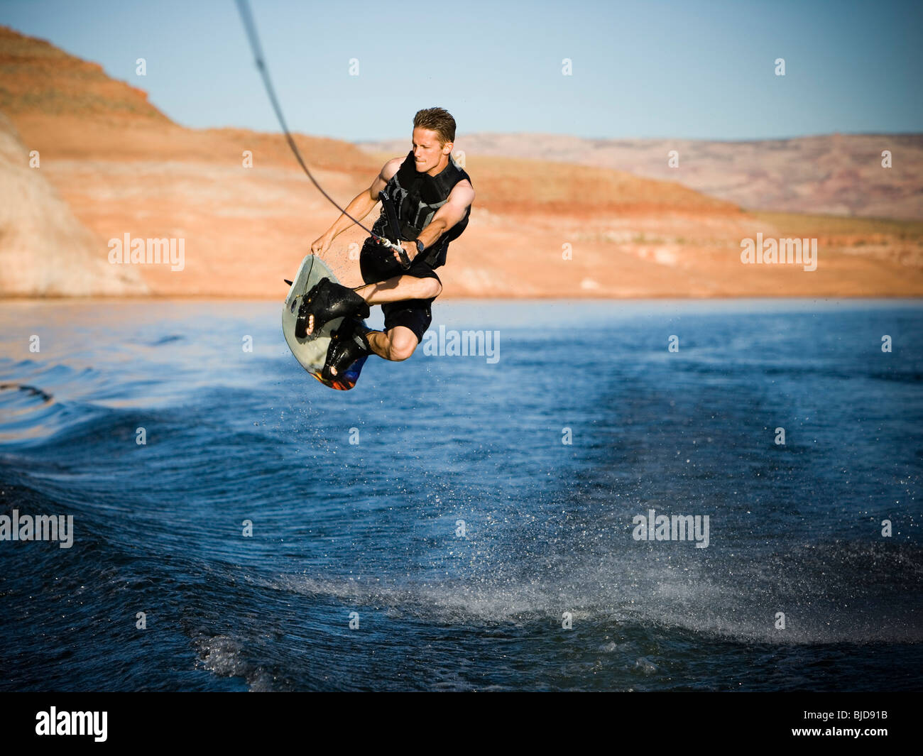 Man on a wakeboard. - Stock Image