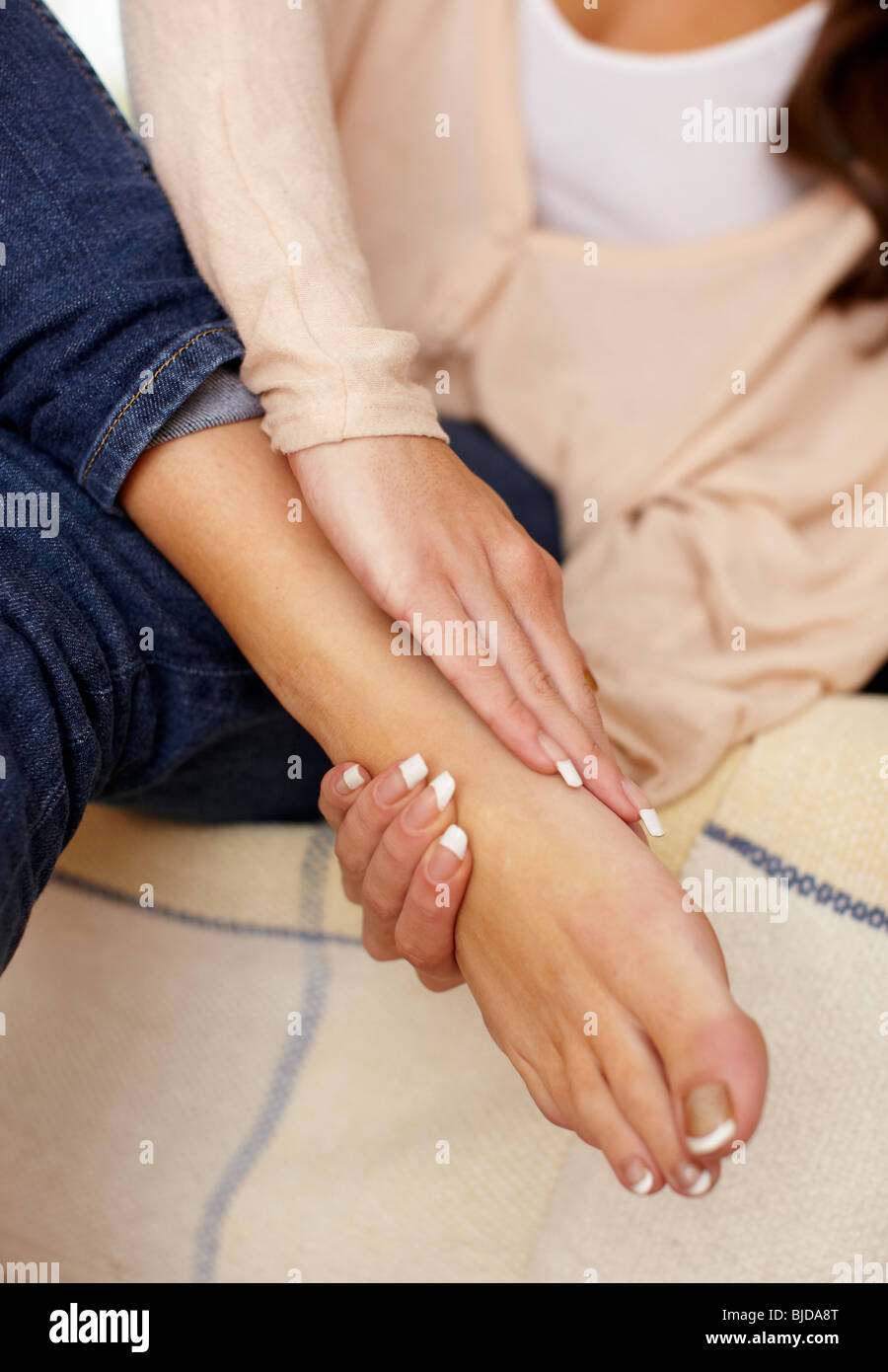 Woman massaging aching feet Stock Photo