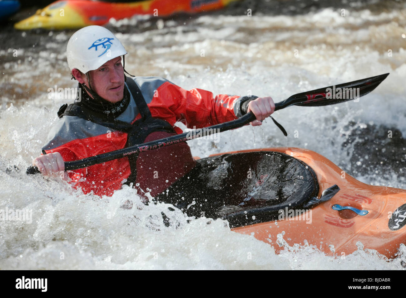 National Whitewater Centre, Frongoch, Gwynedd, North Wales, UK. Kayaker kayaking in white water on Tryweryn River. - Stock Image