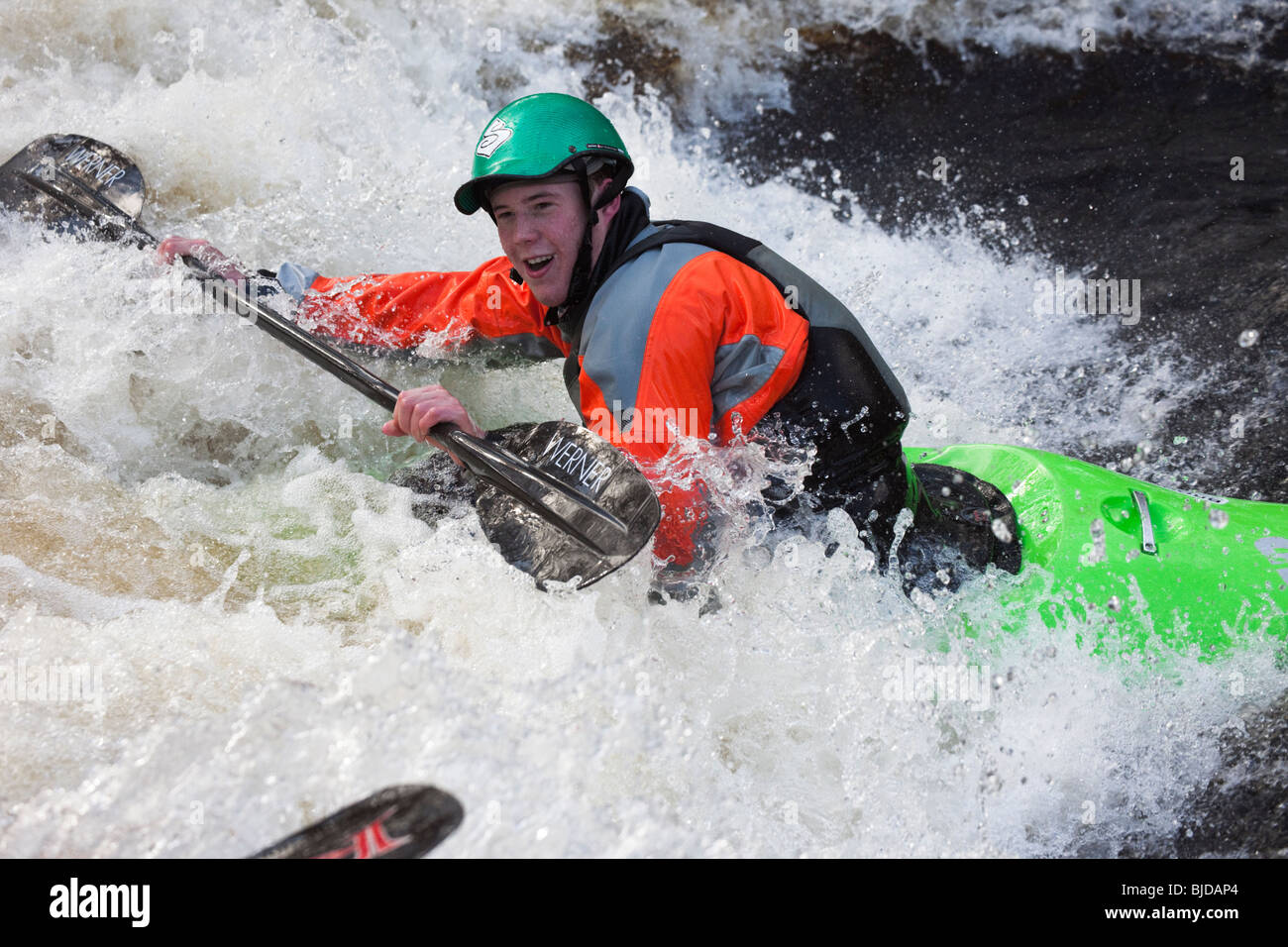 Kayaker kayaking in white water on Tryweryn River. National Whitewater Centre, Frongoch, Gwynedd, North Wales, UK. - Stock Image