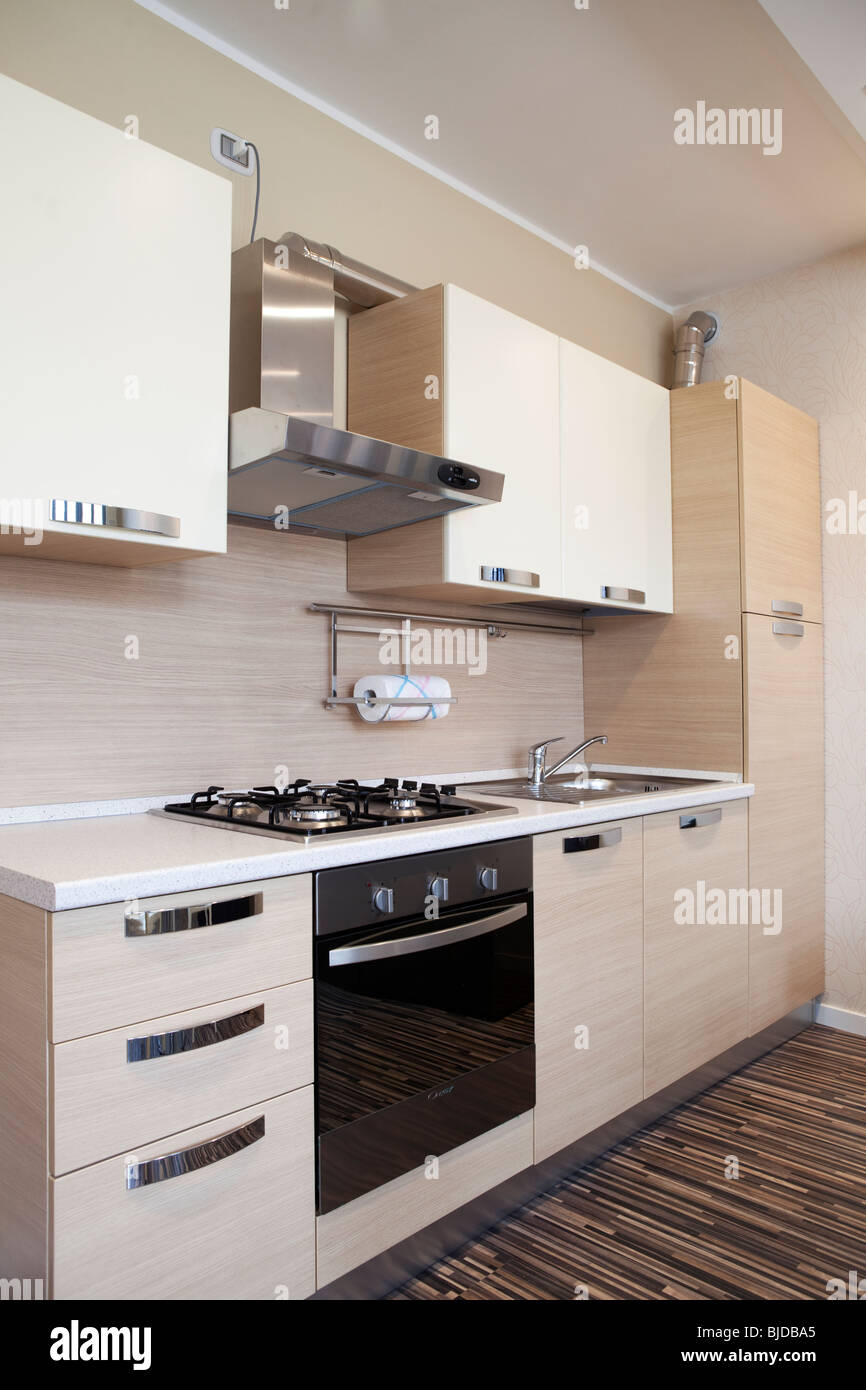 Modern kitchen wall in studio apartment - Stock Image