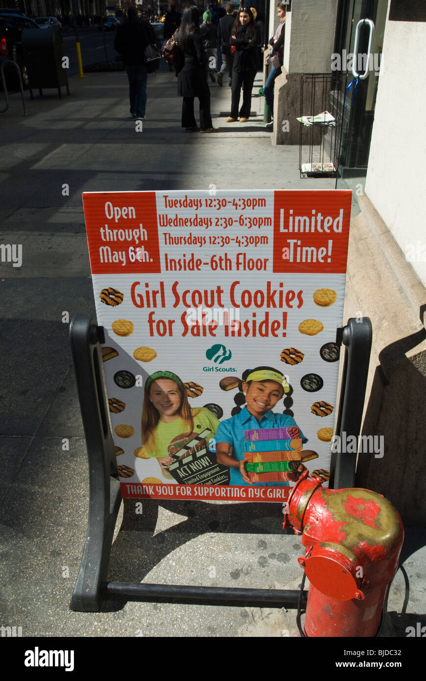 A sign announcing the sale of Girl Scout cookies is seen in the New York neighborhood of Chelsea - Stock Image