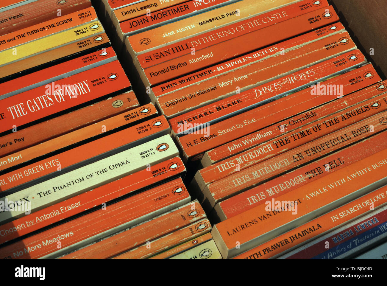A box of Penguin paperbacks at a church sale. - Stock Image
