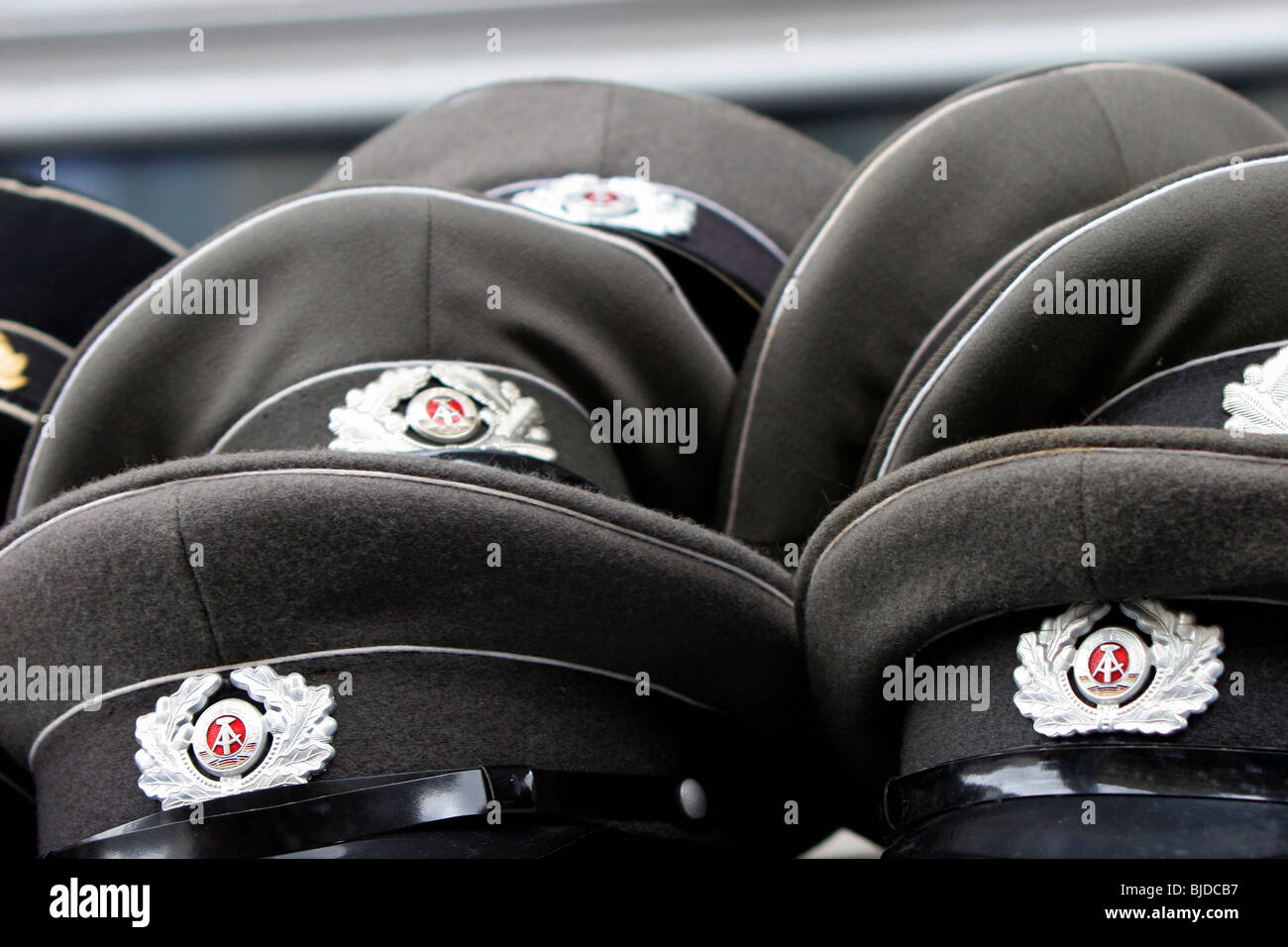 National People's Army military hats - Stock Image
