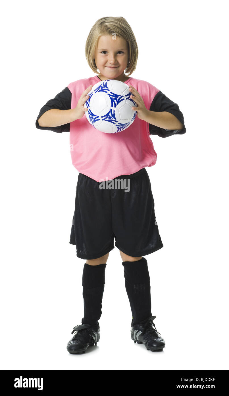 bbb2fe696 Young girl in a soccer uniform with ball Stock Photo  28570291 - Alamy