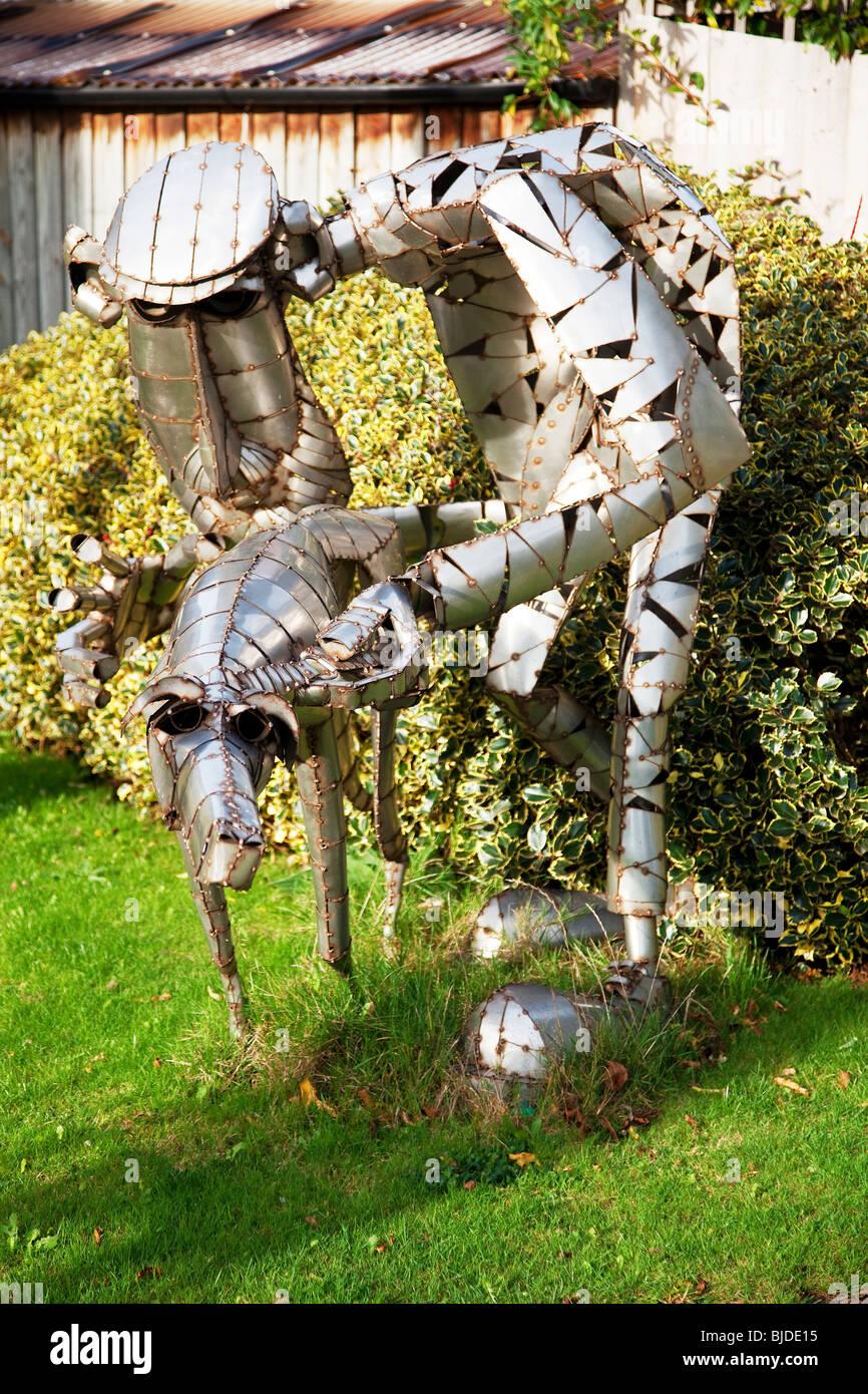 Man and his dog metal sculptures - Stock Image