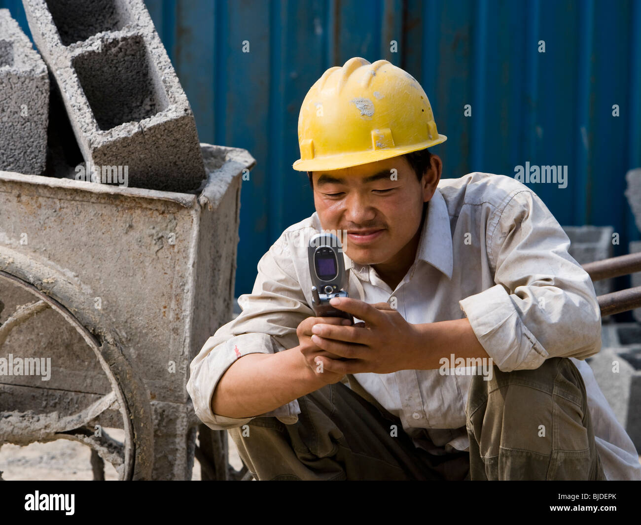 Construction worker looking at his cell phone. Stock Photo