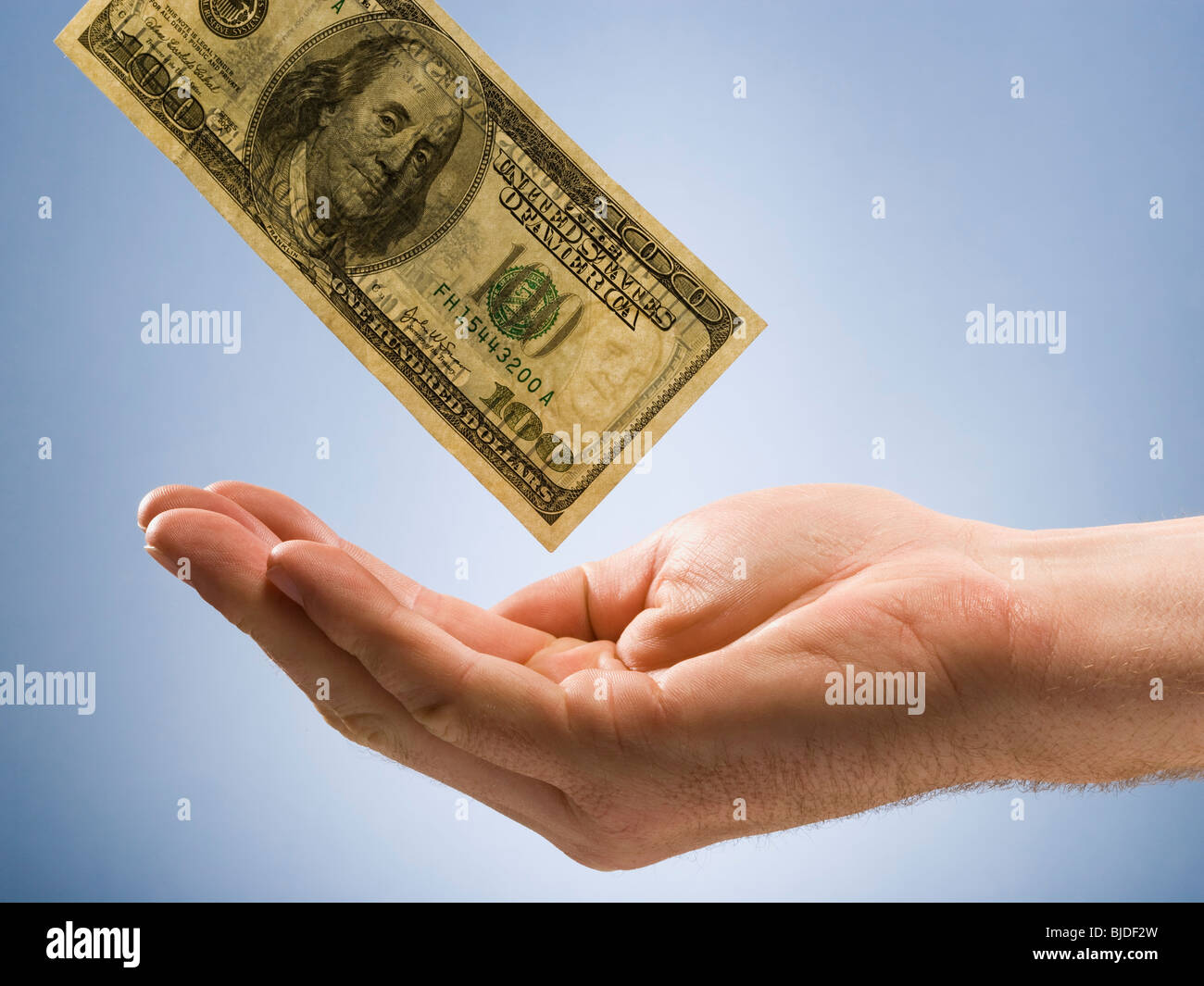 Money into a hand. - Stock Image
