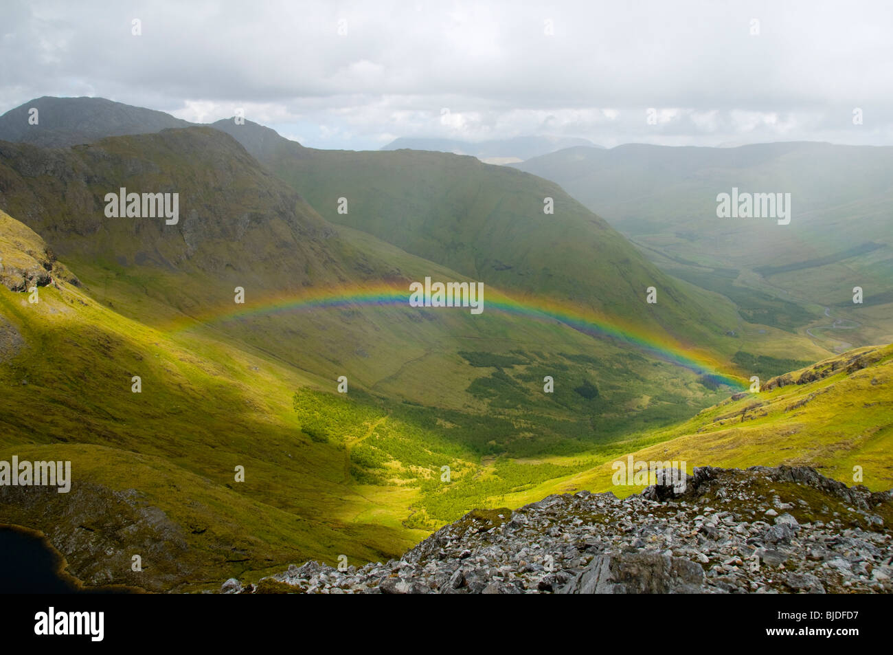 Rainbow below the ridge of the Maumturk Mountains, Connemara, County Galway, Ireland - Stock Image